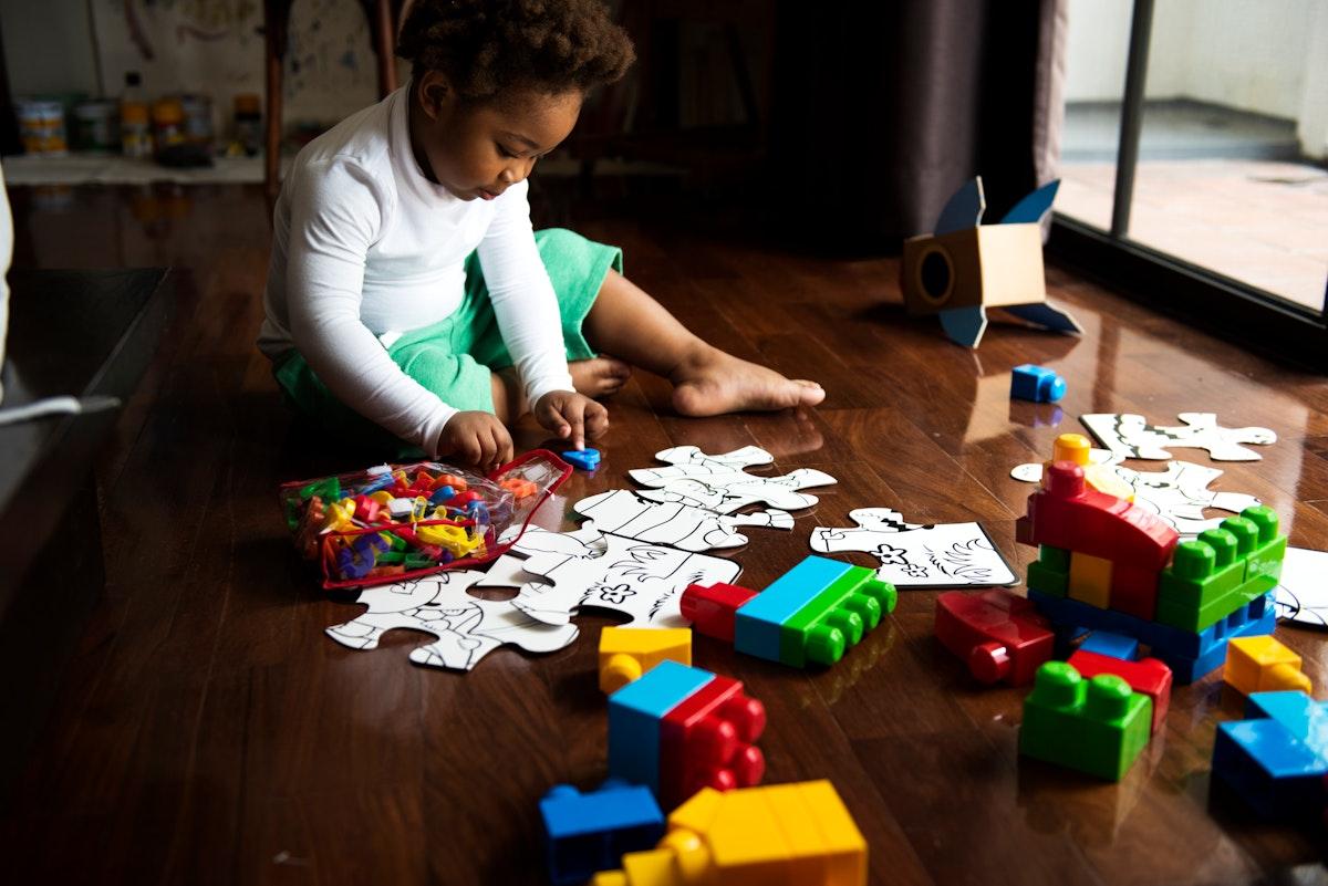 African descent kid enjoying puzzles