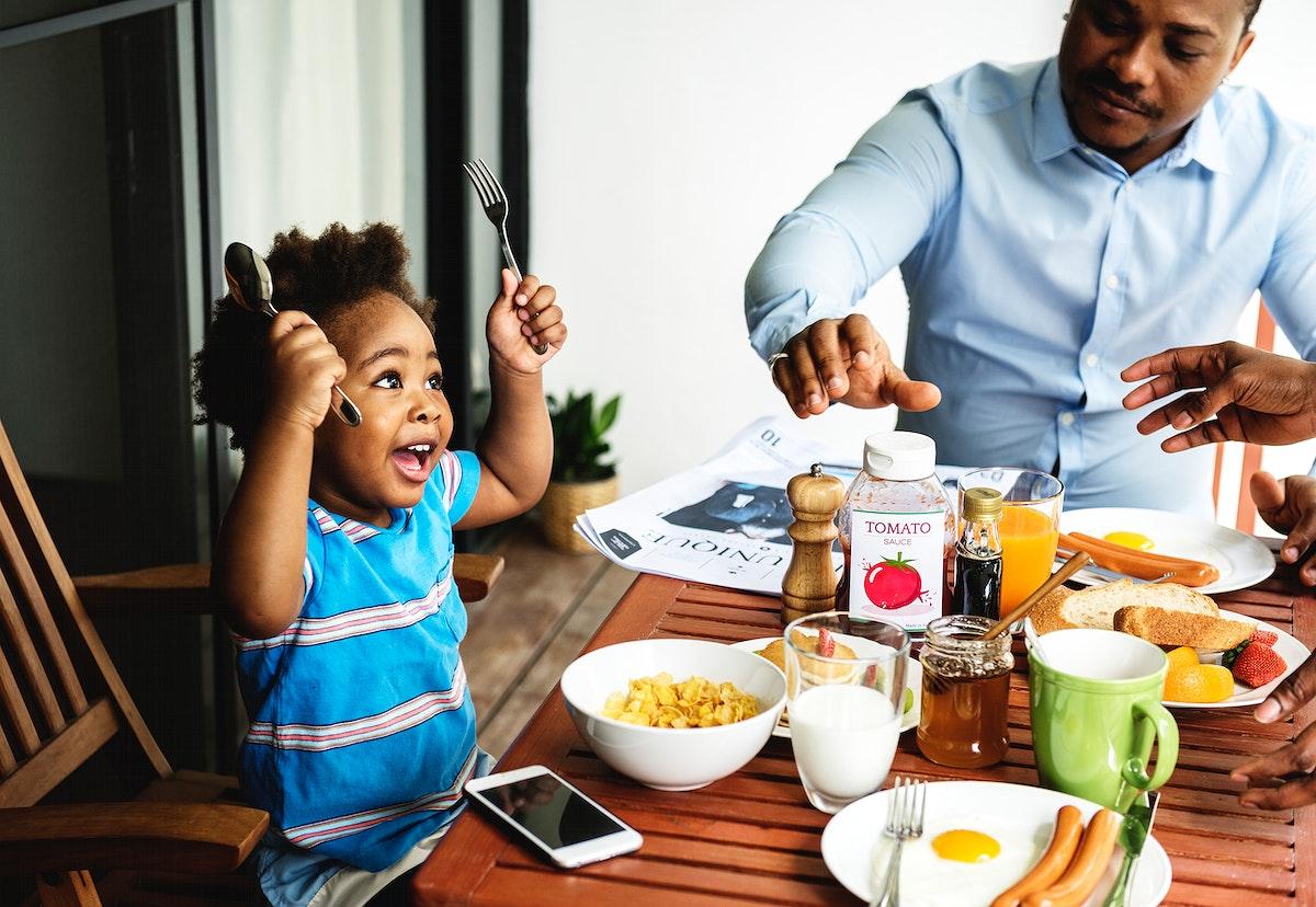 Black family having breakfast together