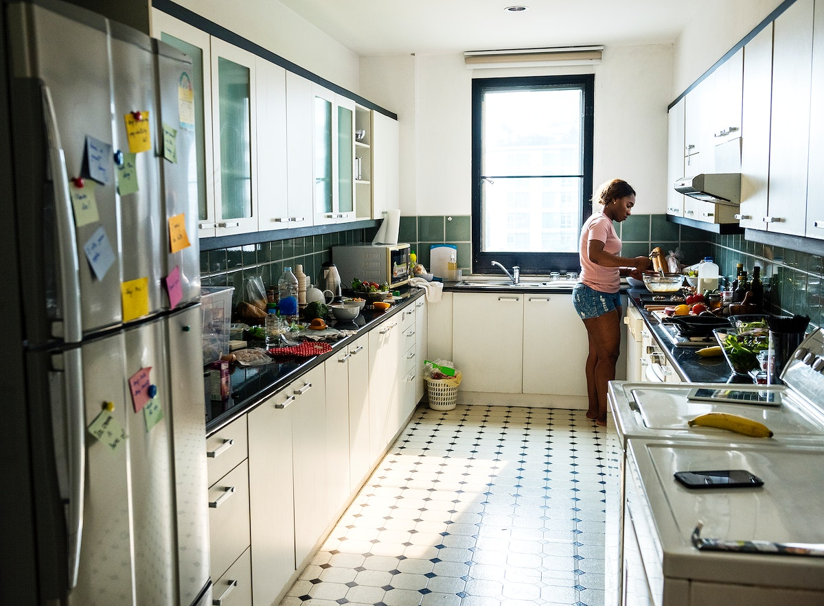 Black woman cooking in the kitchen