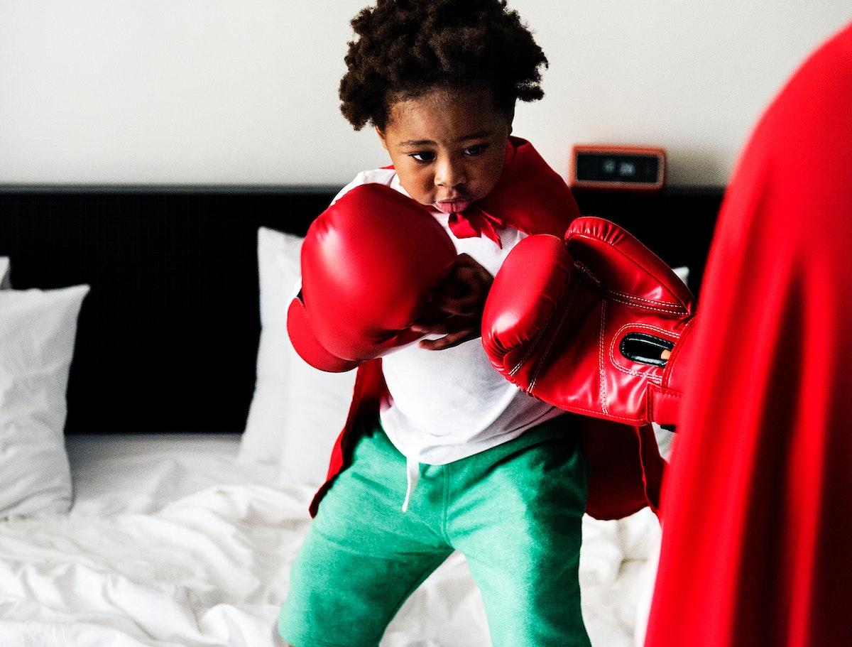 Black kid boxing