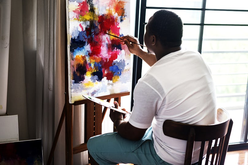 Black artist man doing his art work