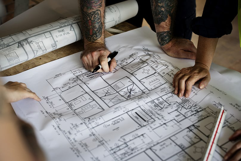Architect working on a blueprint for a new project
