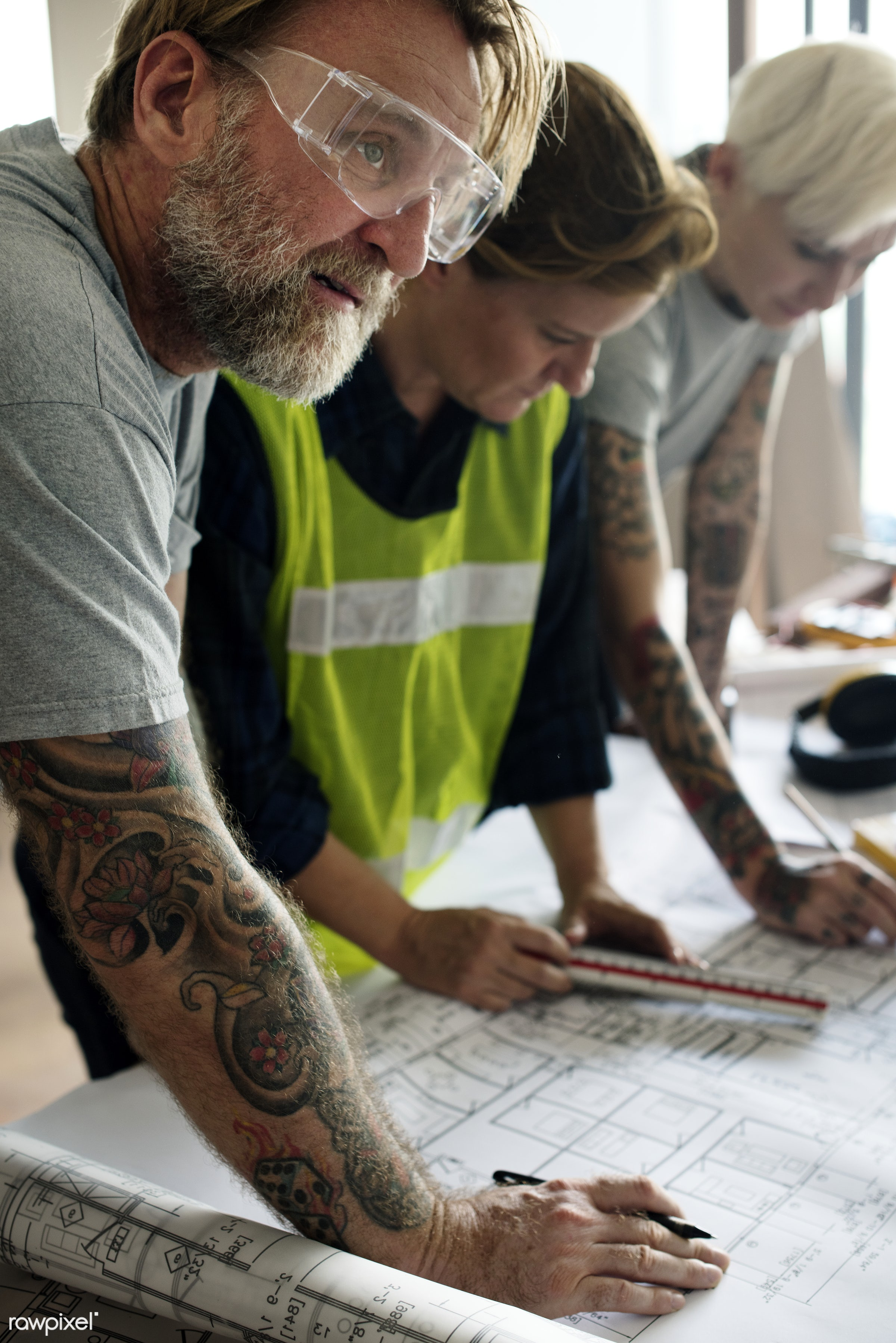 Construction team working on a blueprint for a new project - american, architect, architectural, architecture, blueprint,...