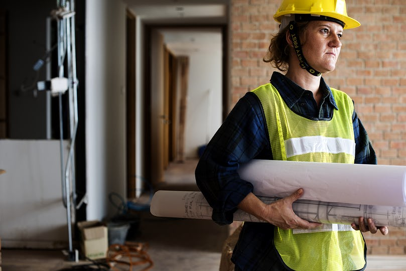 Construction woman holding blueprint