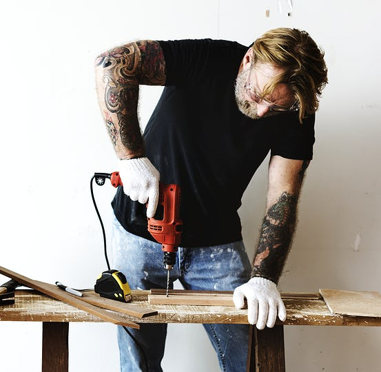 Constractor handyman working and using screwdriver