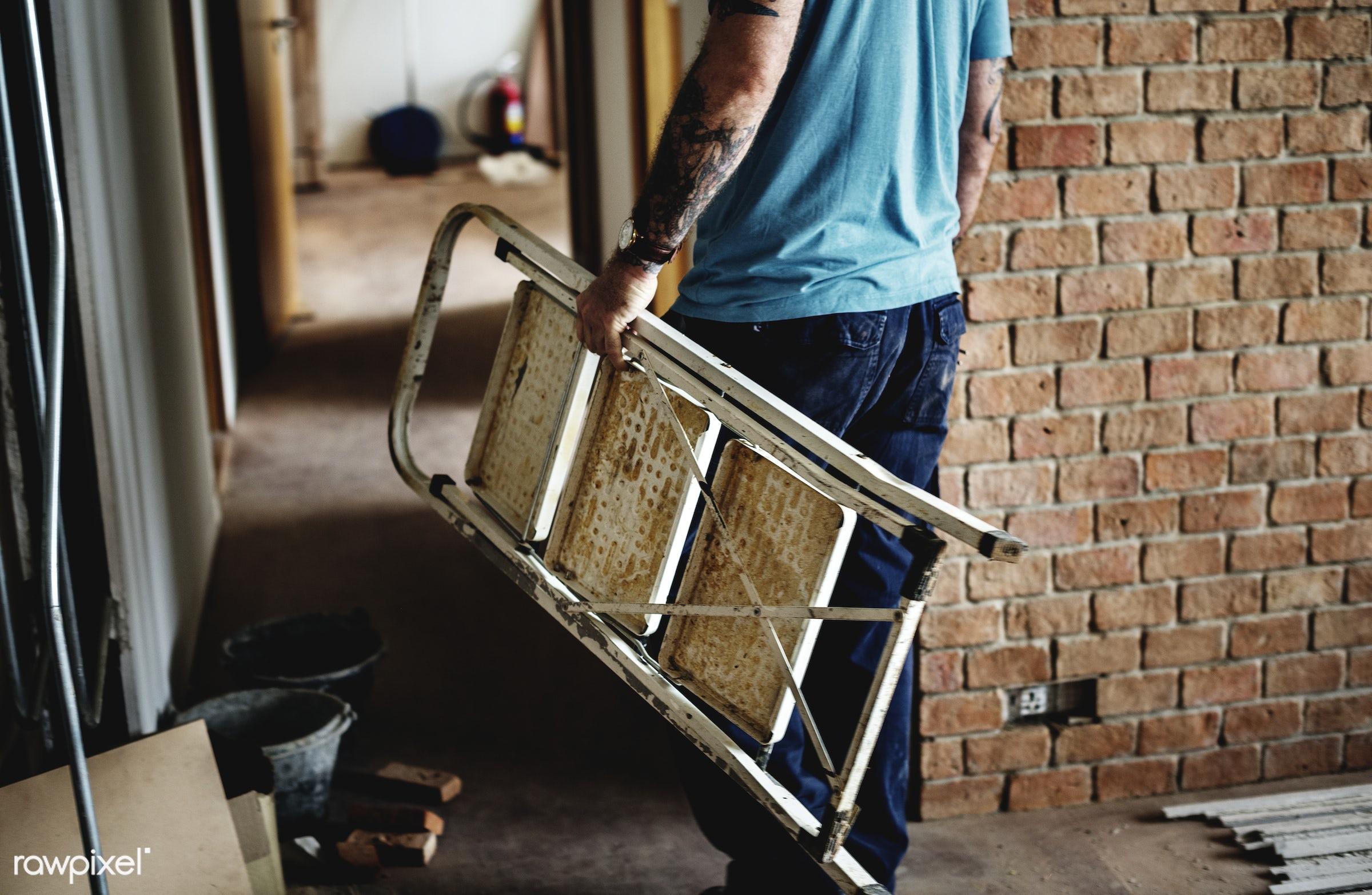 Construction worker carrying a steel ladder - ladder, renovating, brick, builder, equipment, build, tools, materials,...
