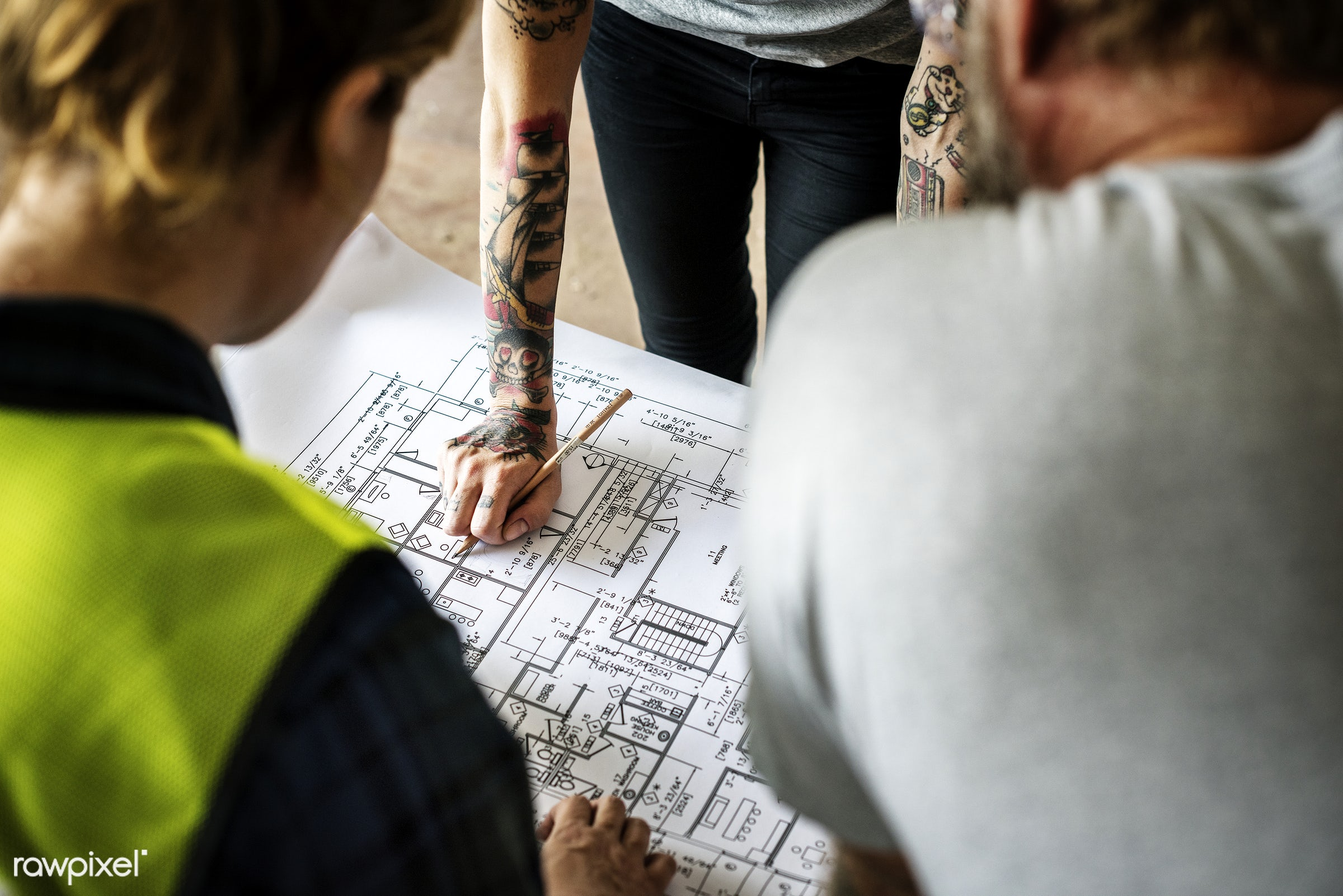 Construction team working on a blueprint for a new project - architect, architectural, architecture, blueprint, build,...