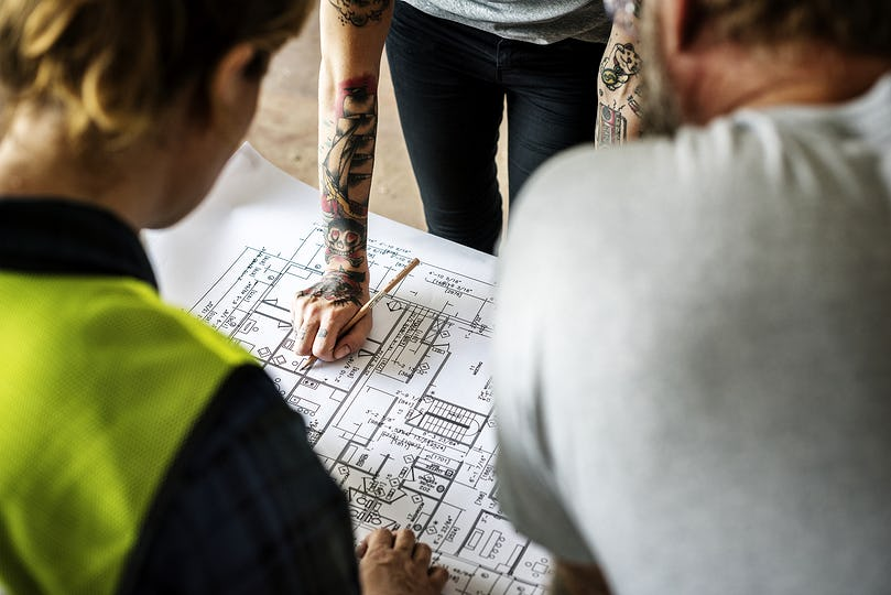 Construction team working on a blueprint for a new project