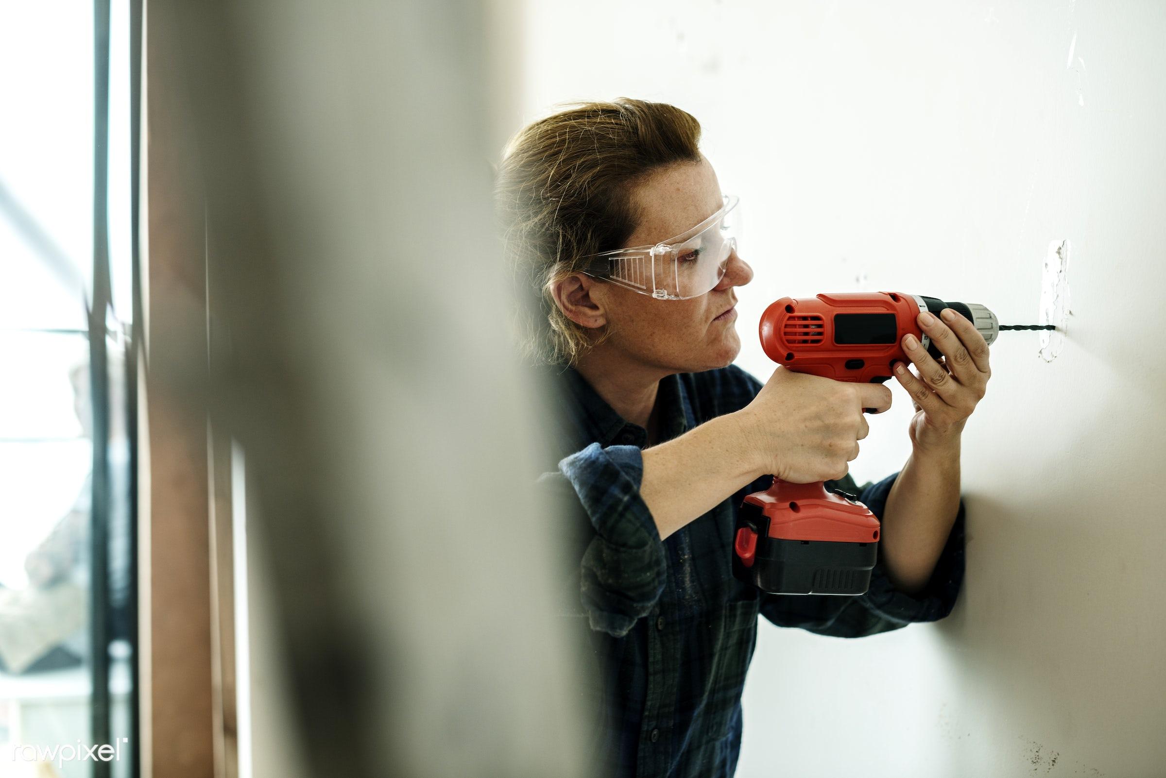 Construction woman drilling - builder, contractor, american, british, carpenter, construction, development, drill, drilling...