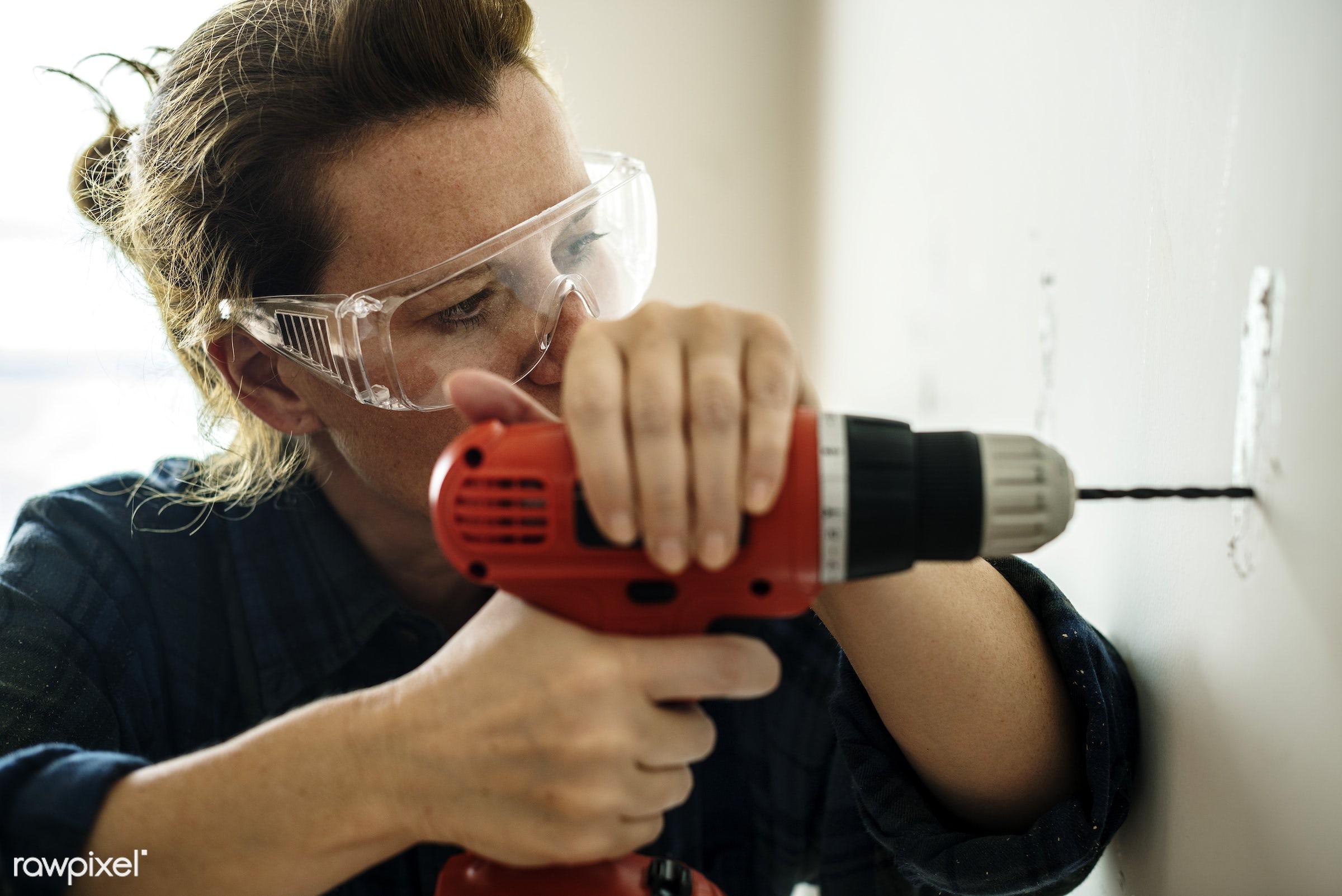 Construction woman drilling  - american, british, builder, carpenter, construction, contractor, development, drill, drilling...