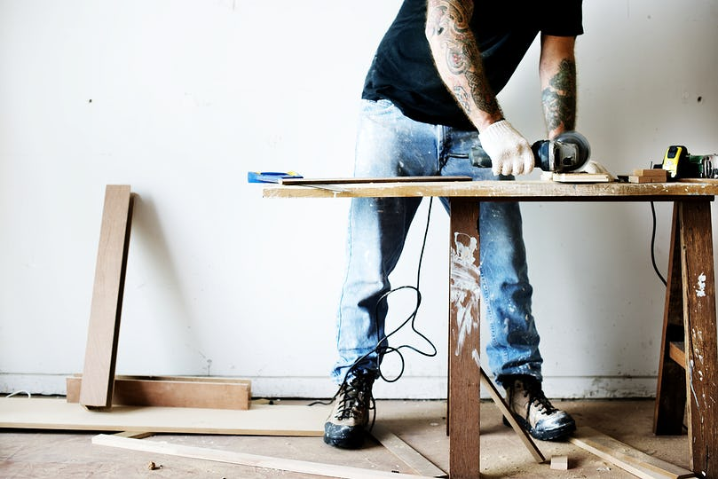 Carpenter working with a wood