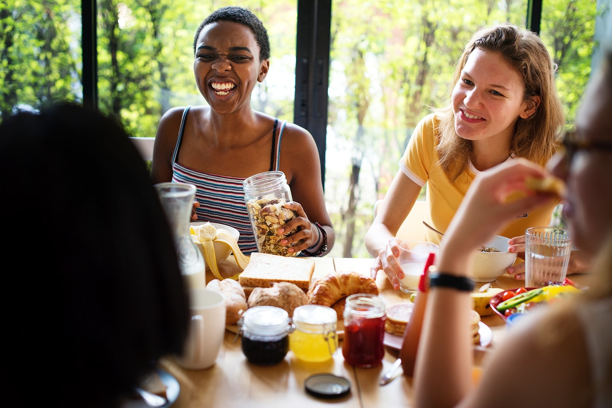 A group of diverse women having breakfast together
