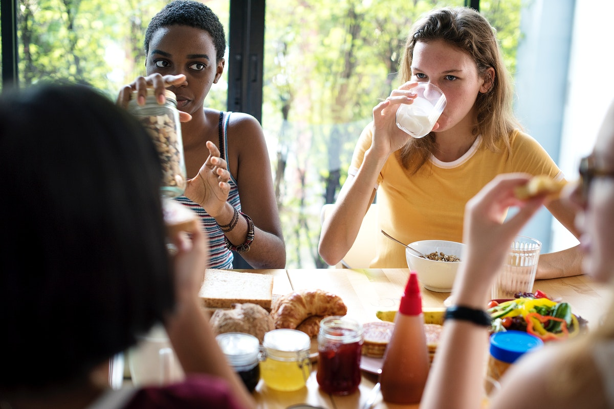 Group of diverse women having breakfast together