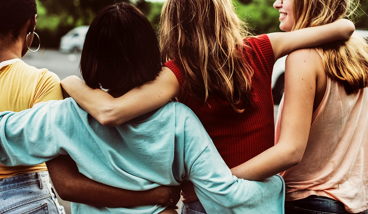 Rear view of a group of diverse woman friends walking together