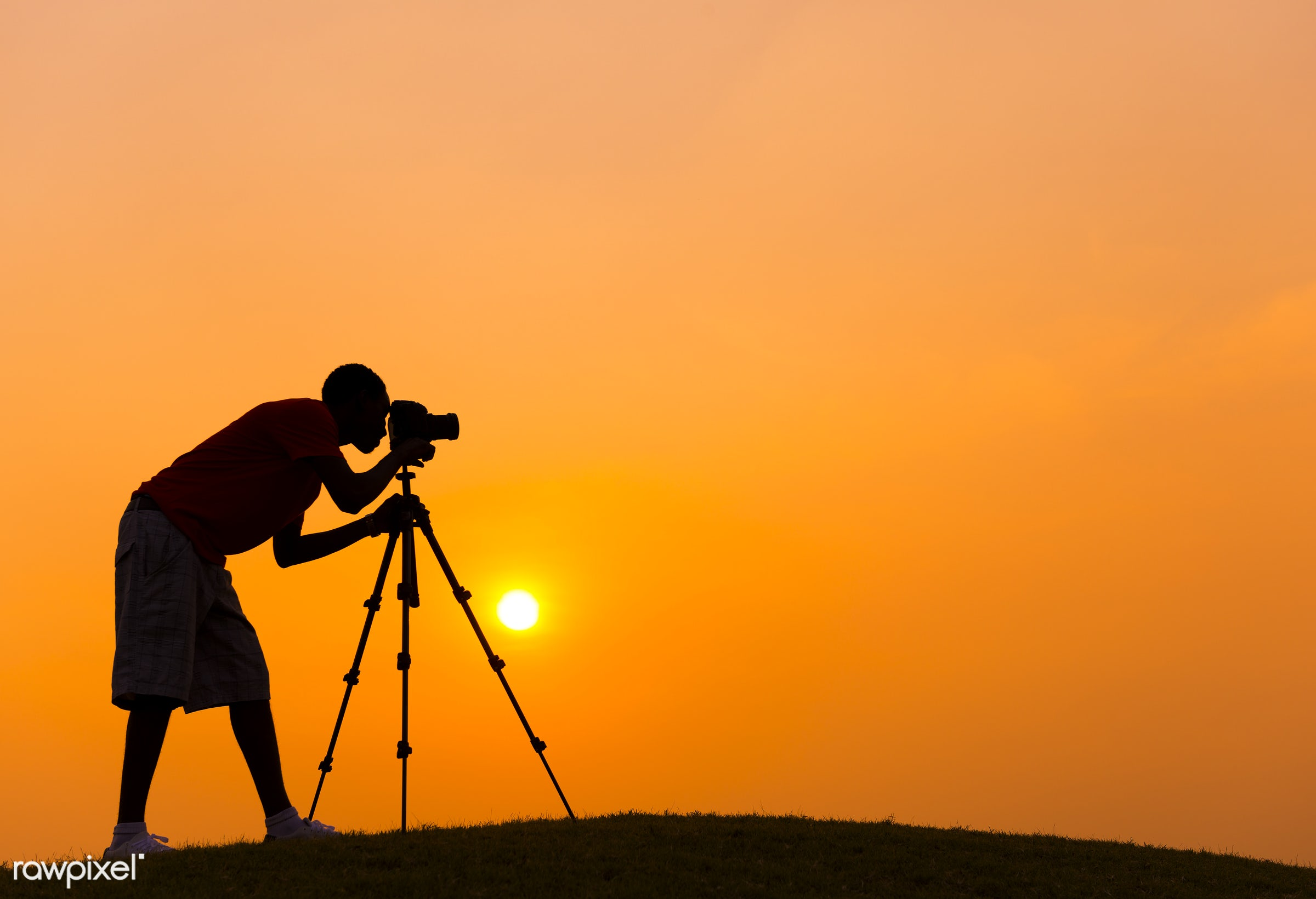 Camera man taking a photo outdoors with a sunset backdrop - travel, camera, dawn, dusk, equipment, evening, golden,...