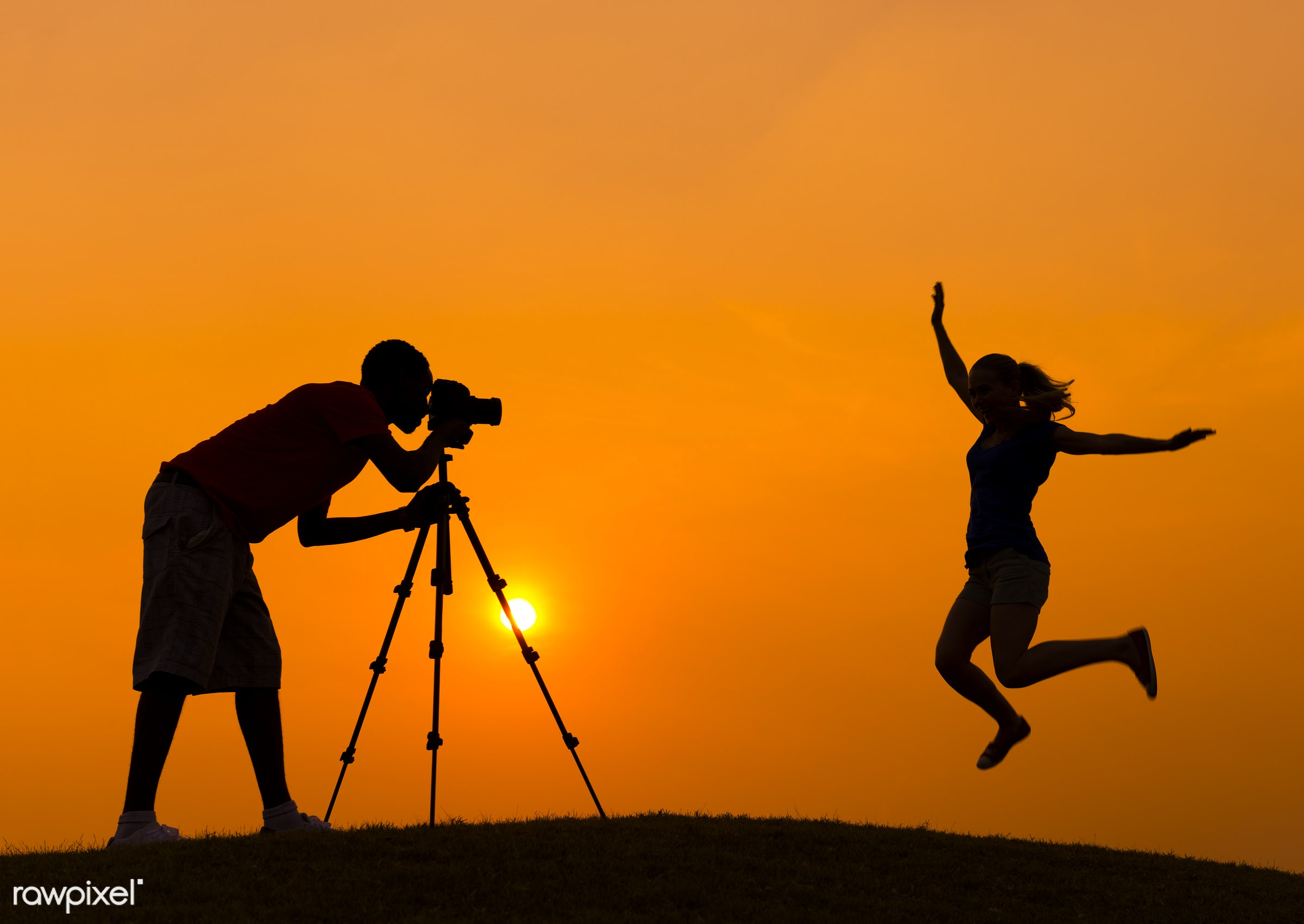 Silhouette of a man taking a photo of her girlfriend - dusk, heterosexual couple, lifestyles, slr camera, camera, couple,...