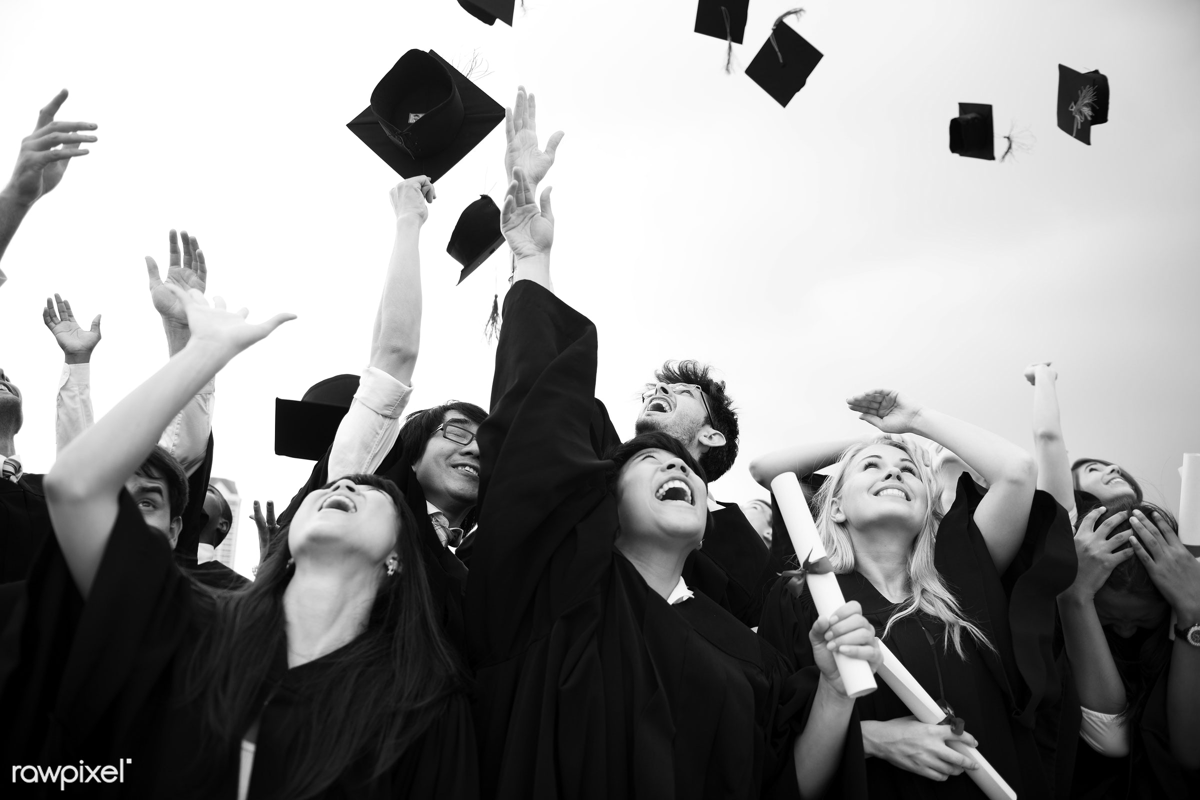 Group of diverse graduating students - african descent, asian, black, black and white, caps, caucasian, ceremony,...