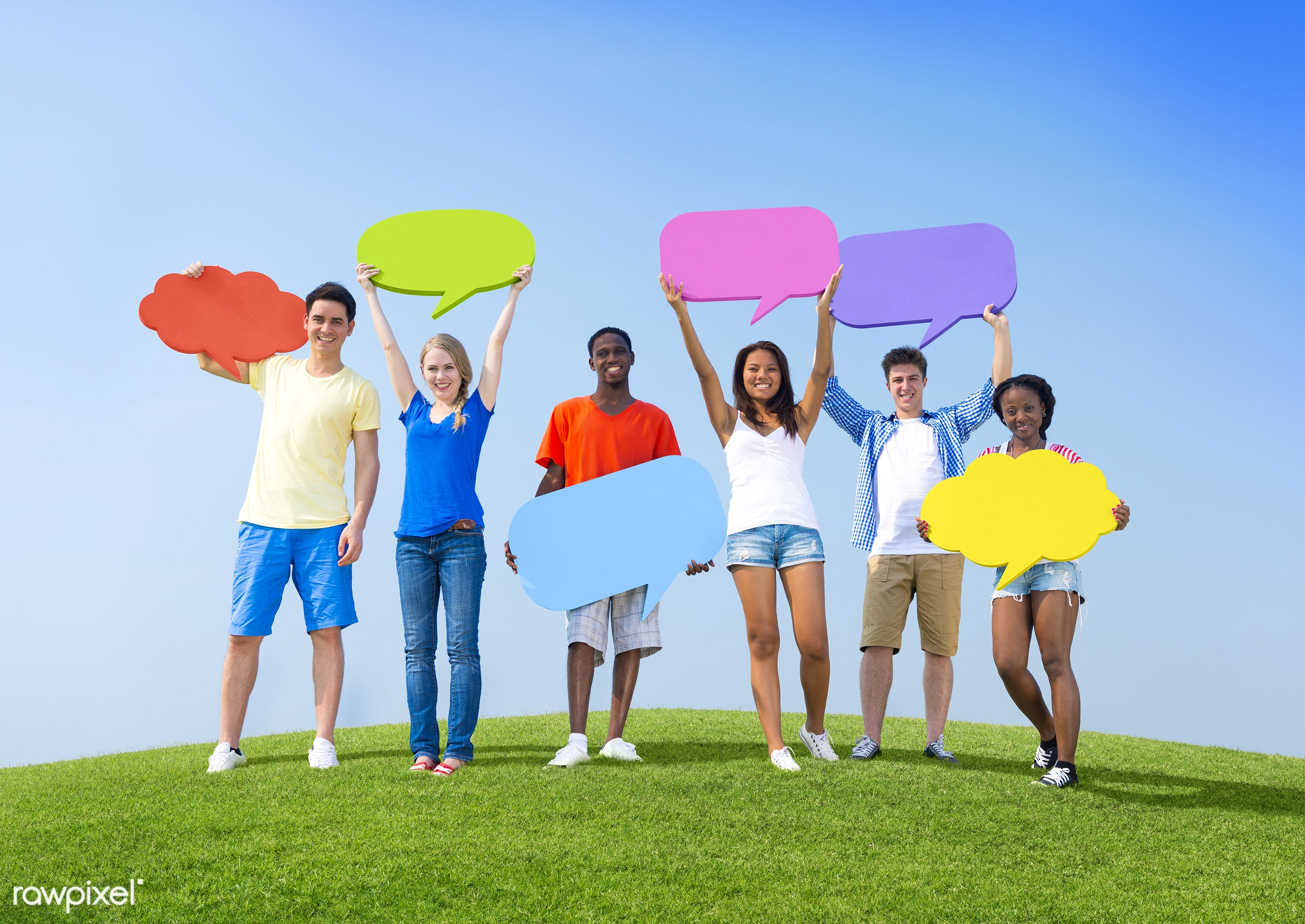Diverse young people holding black speech bubble paper cutouts - holding, arm raised, blue sky, bubble, chat box, chat...