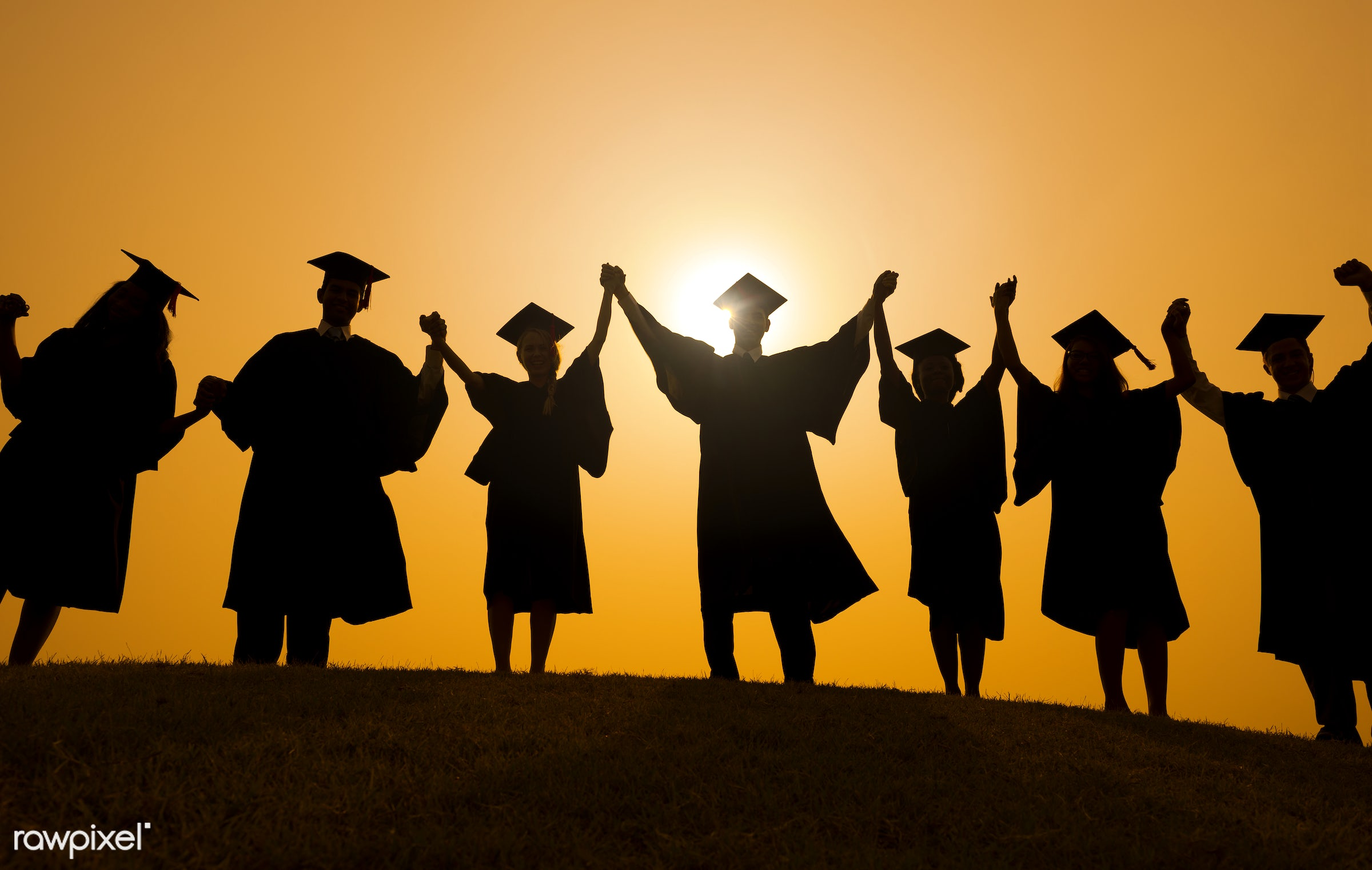 Group of diverse graduating students - education, achievement, adult, arms outstretched, arms raised, celebration,...