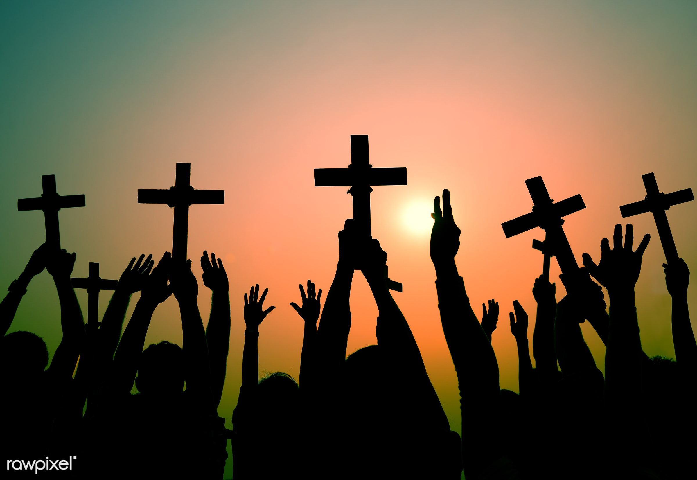 holding, holidays and celebrations, arm raised, belief, cemetery, christianity, concepts and ideas, cross, crucifix, death,...