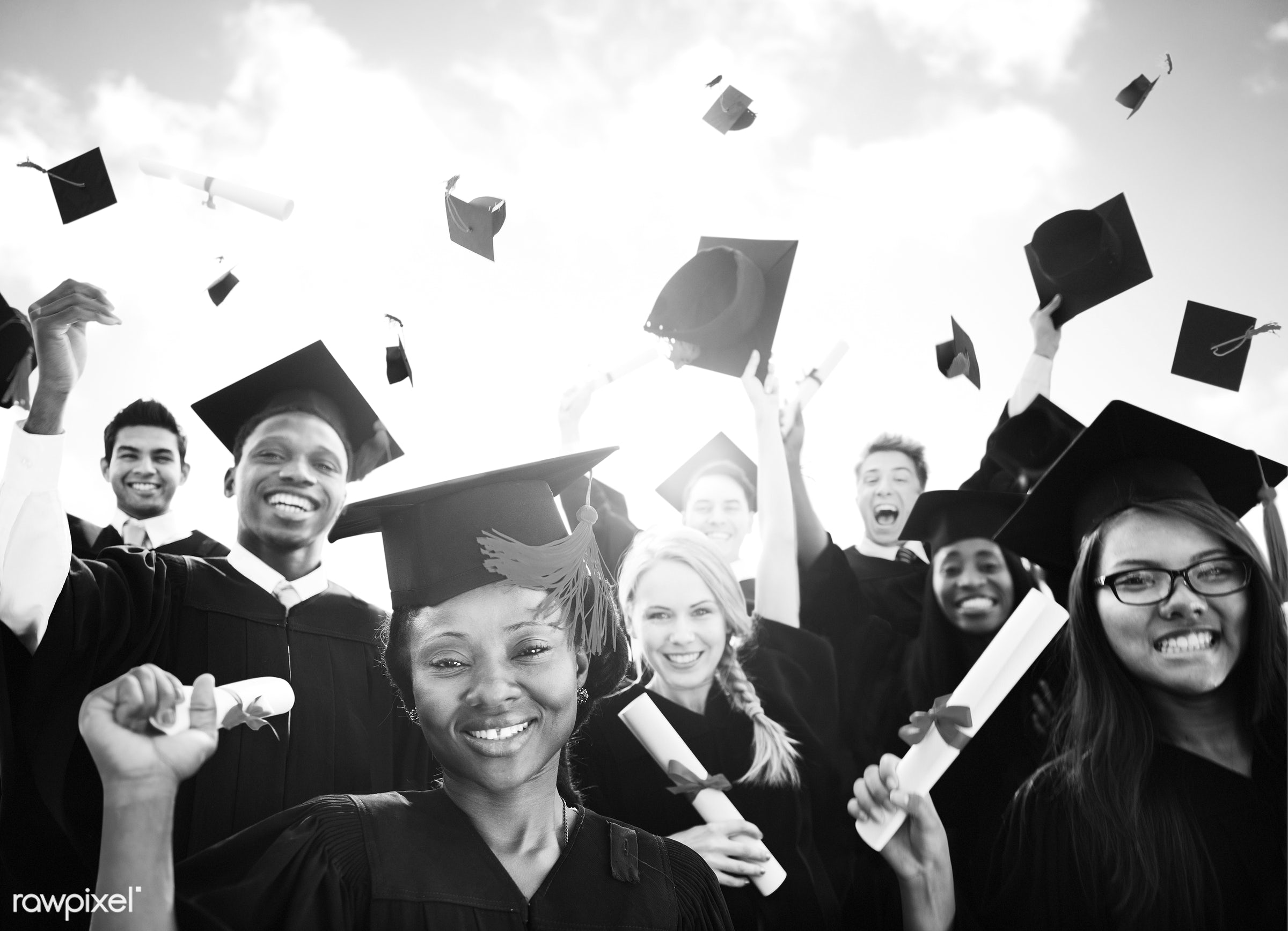 Cheerful students in their graduation gown and hat - academic, achievement, african, african american, african descent,...