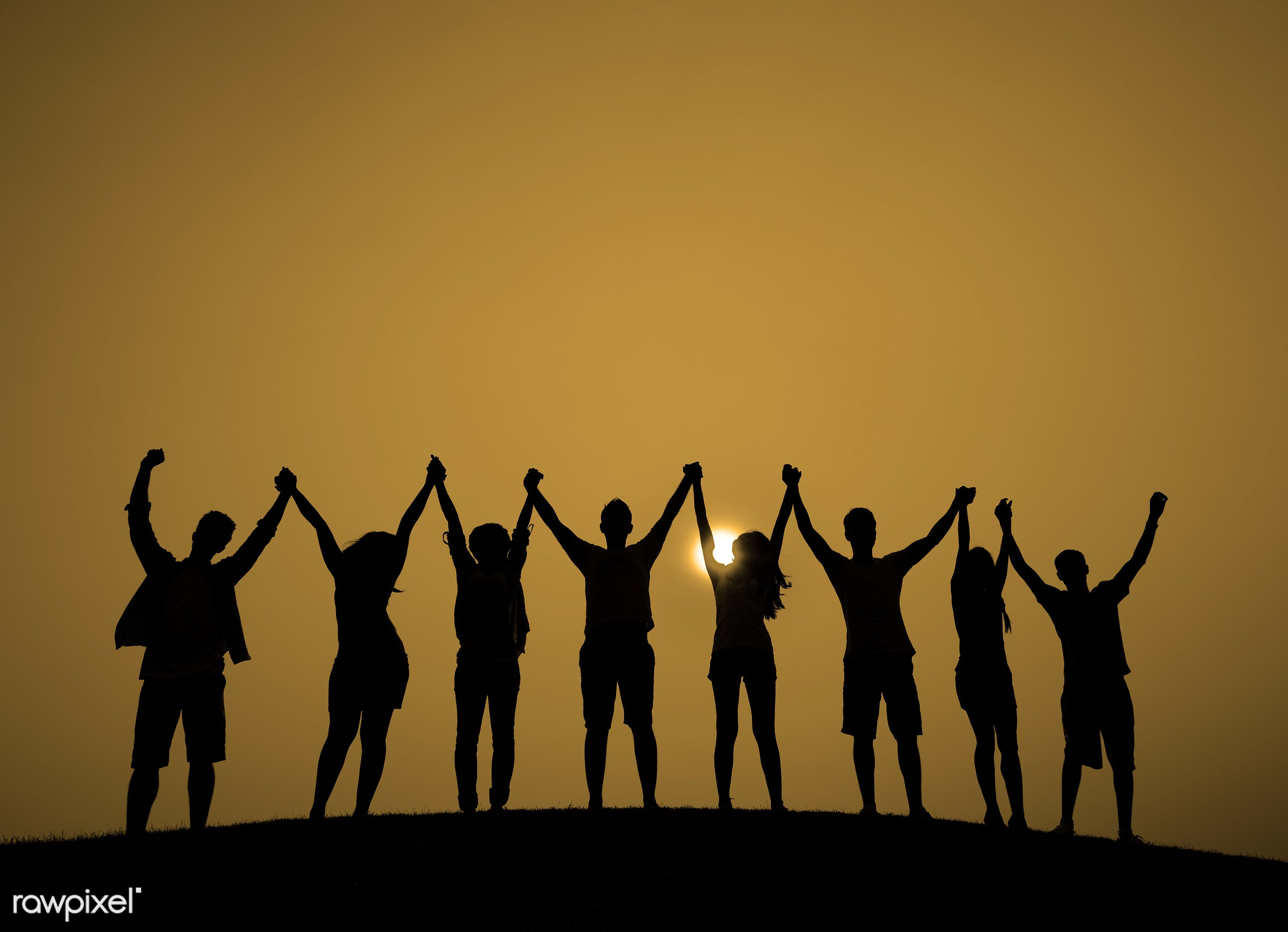 achievement, arms outstretched, arms raised, backlit, casual, celebration, cheerful, color image, community, teamwork, group...