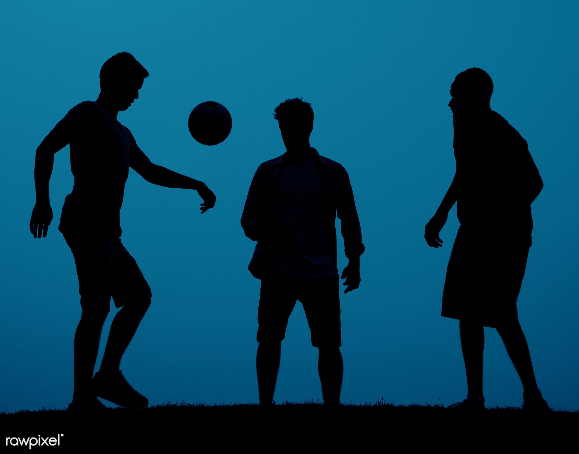 dusk, action, active, ball, blue, evening, field, football, friendship, fun, game, grass, kicking, leisure activity, leisure...