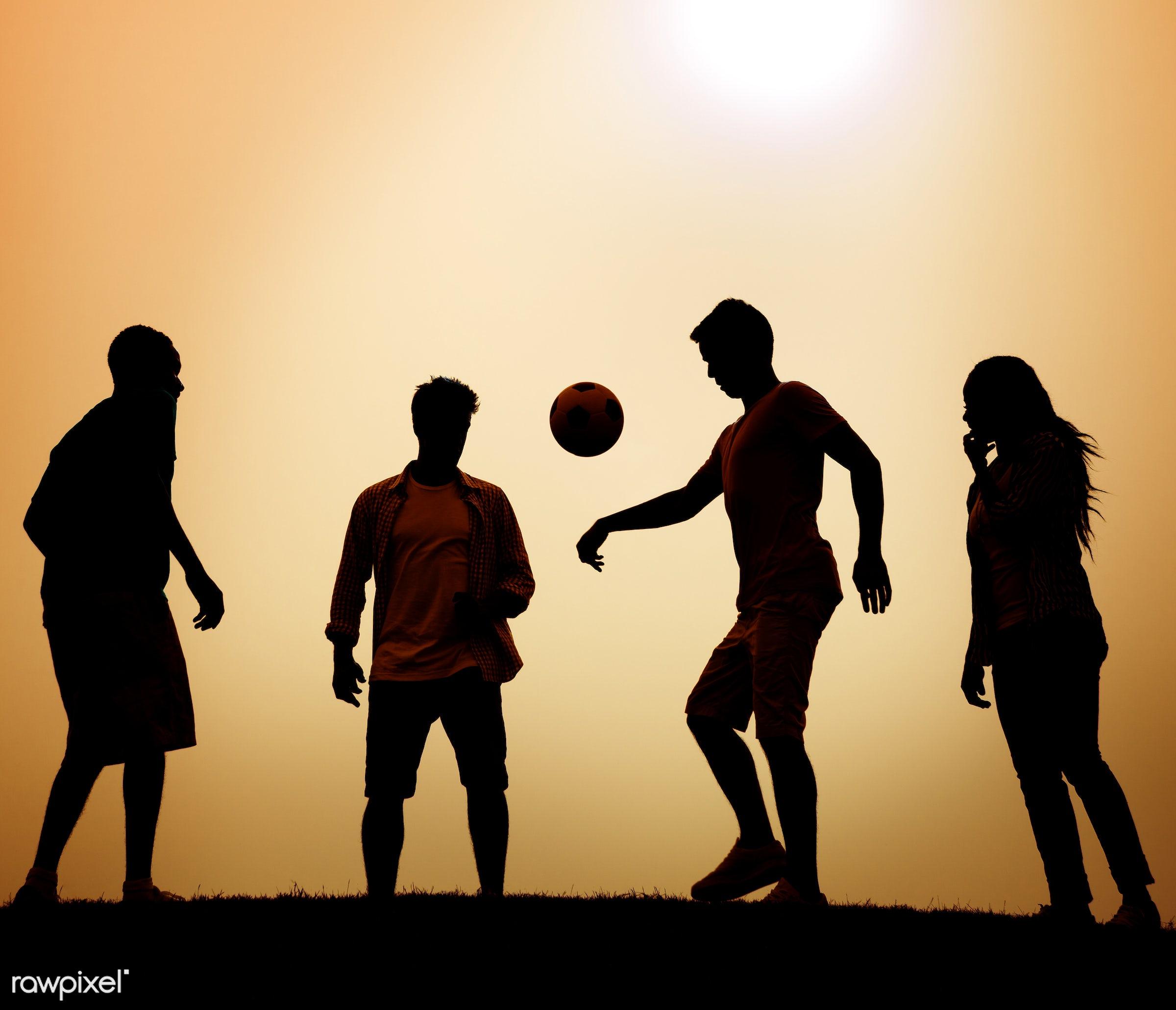 dusk, action, active, ball, boys, evening, field, football, friendship, fun, game, girl, grass, kicking, leisure activity,...