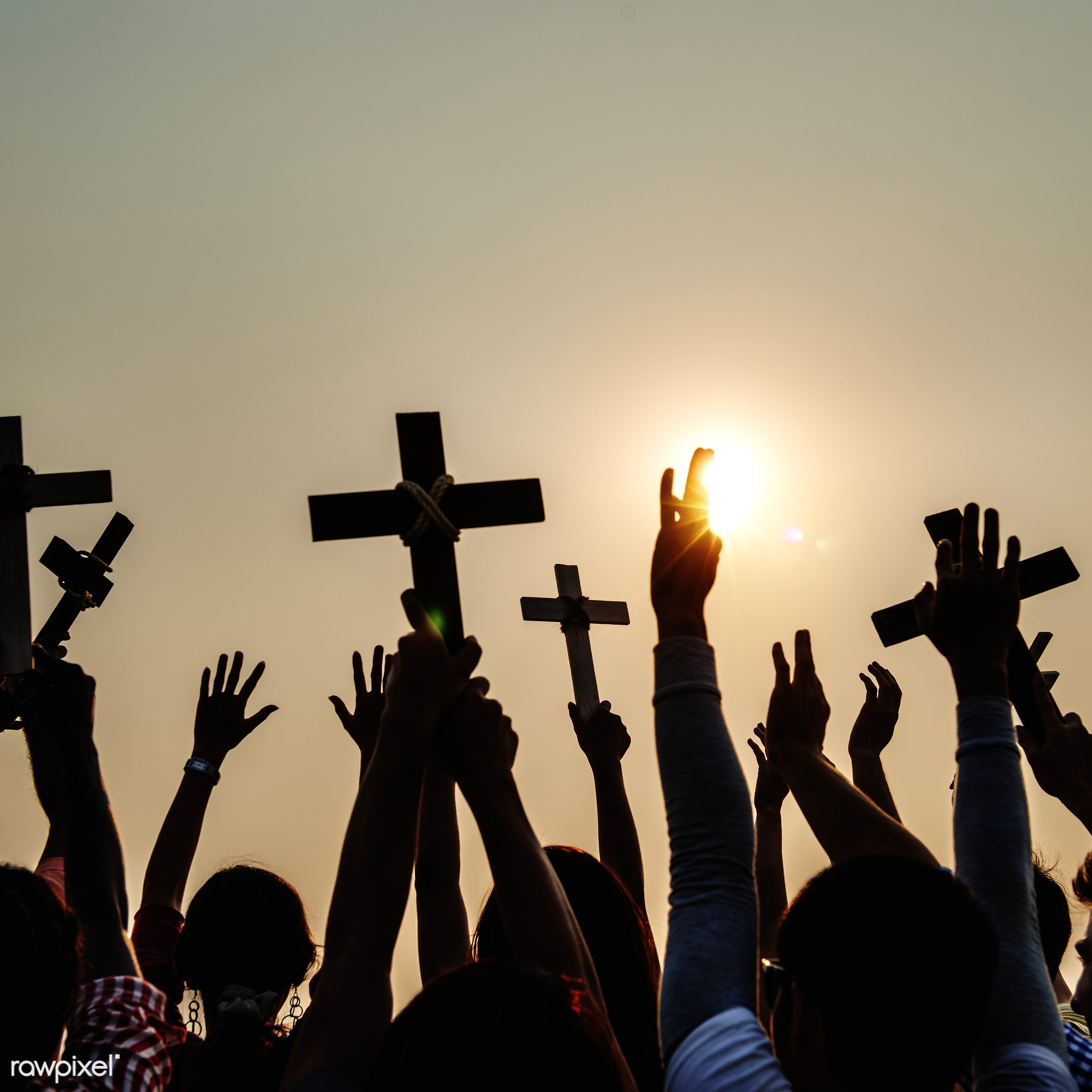 Christians holding up crosses - arms raised, back lit, belief, carefree, catholic, celebration, cheerful, christian,...