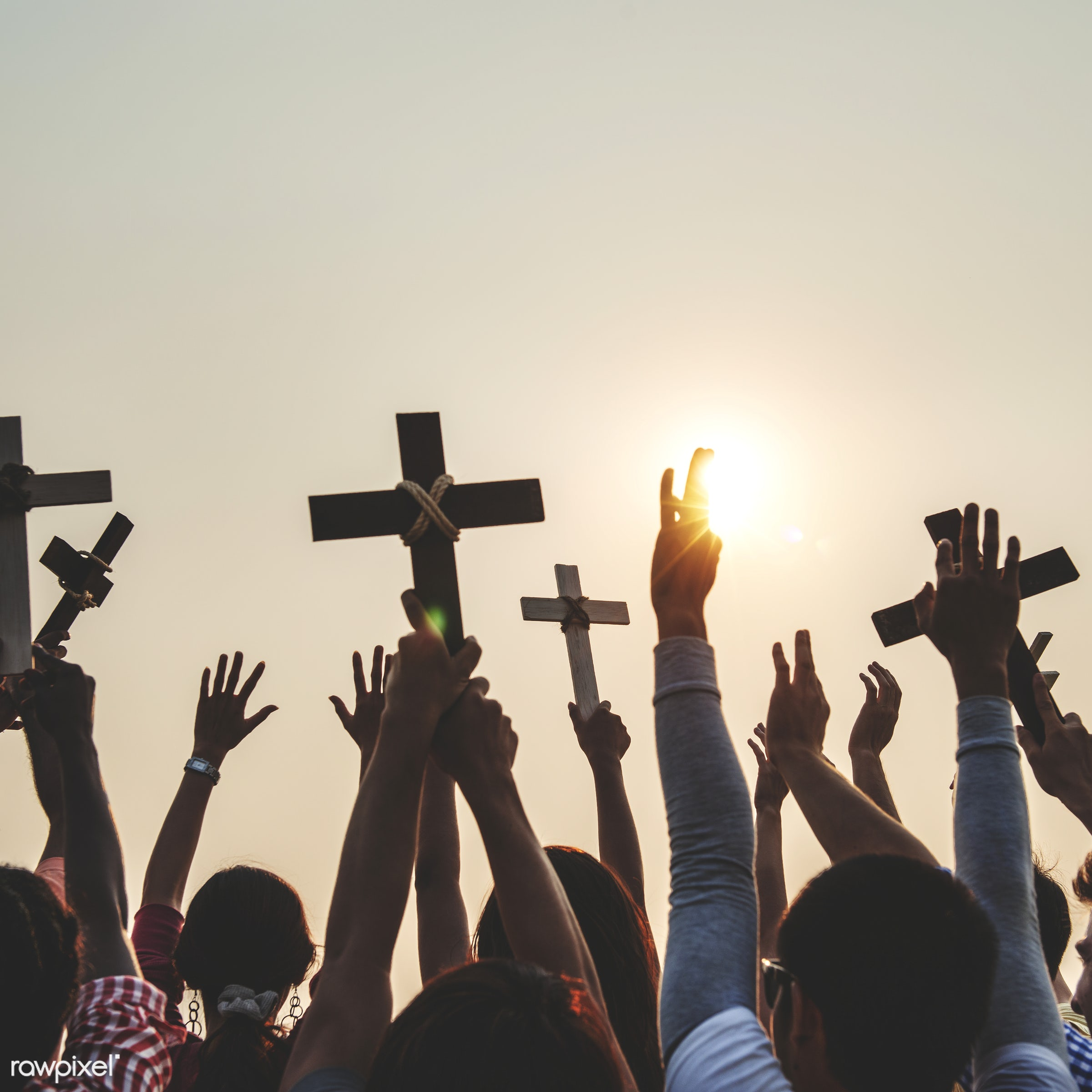 Christians holding up crosses - catholic, cross, arms raised, back lit, belief, carefree, celebration, cheerful, christian,...