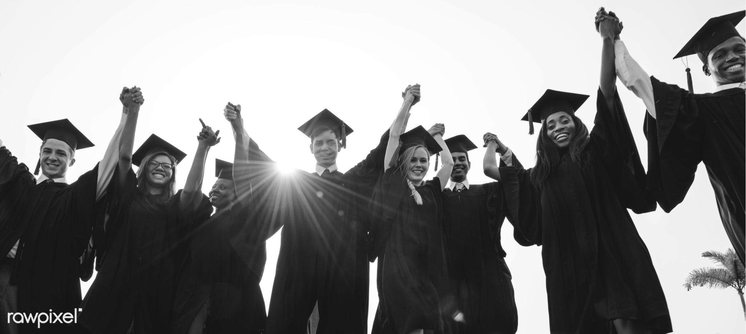 Group of diverse graduating students - education, achievement, african, alumni, asian, best friends, caucasian, celebrate,...
