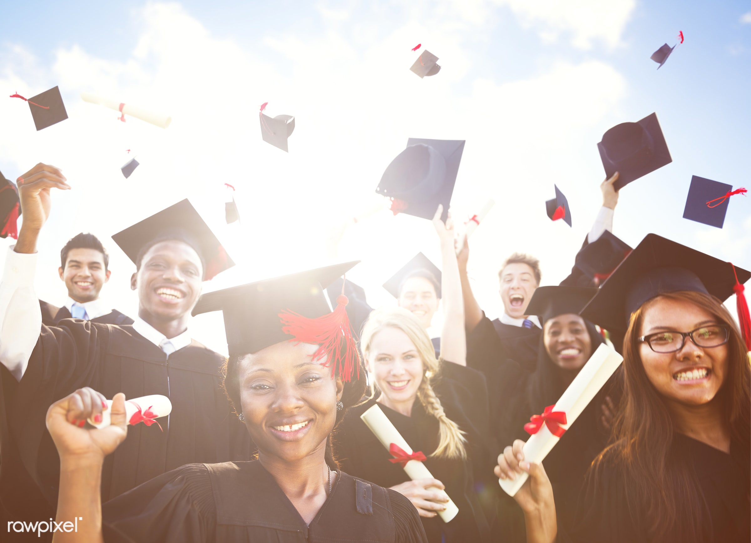 Diverse graduates throwing their hats - academic, achievement, african, african american, african descent, african ethnicity...