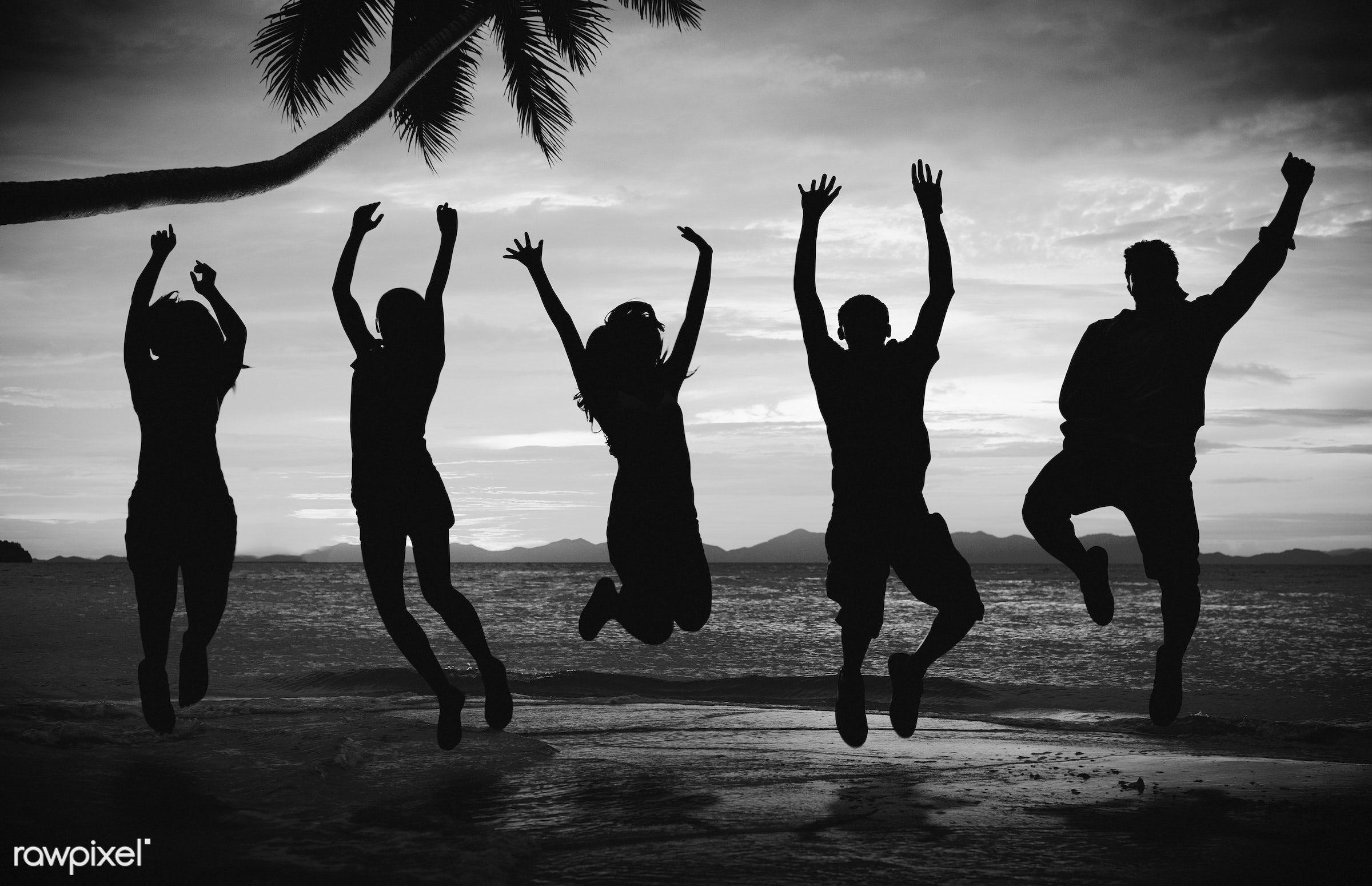 Silhouette of people doing a jump shot on the beach - adult, african, african descent, back lit, ball, beach, beach ball,...