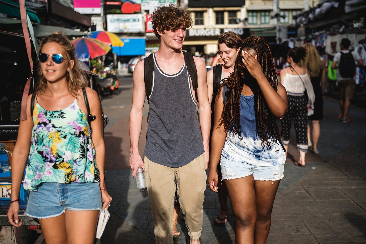 Group of tourists walking on the street