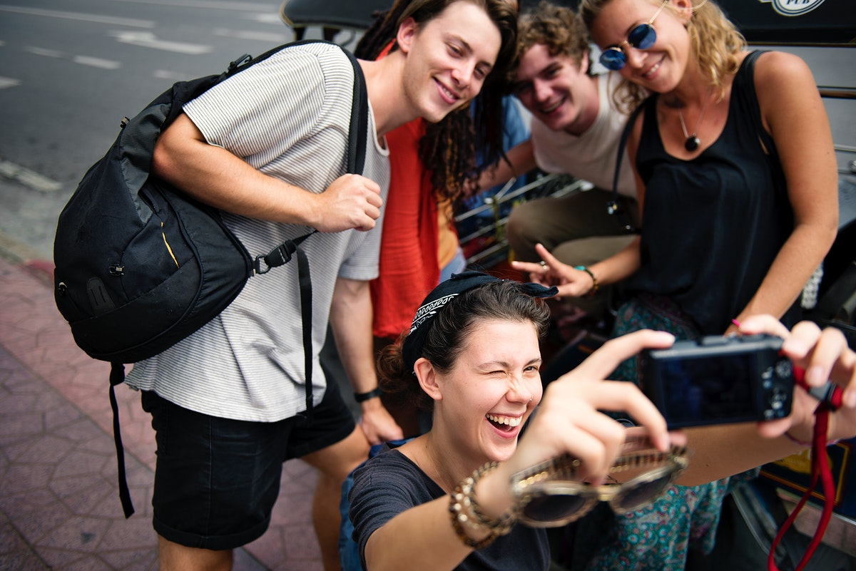 Group of tourists taking selfie together