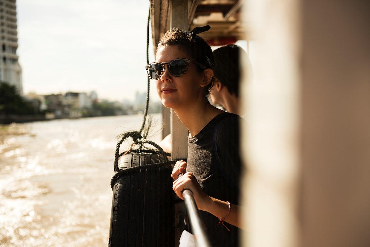 A Caucasian woman enjoying the boat ride