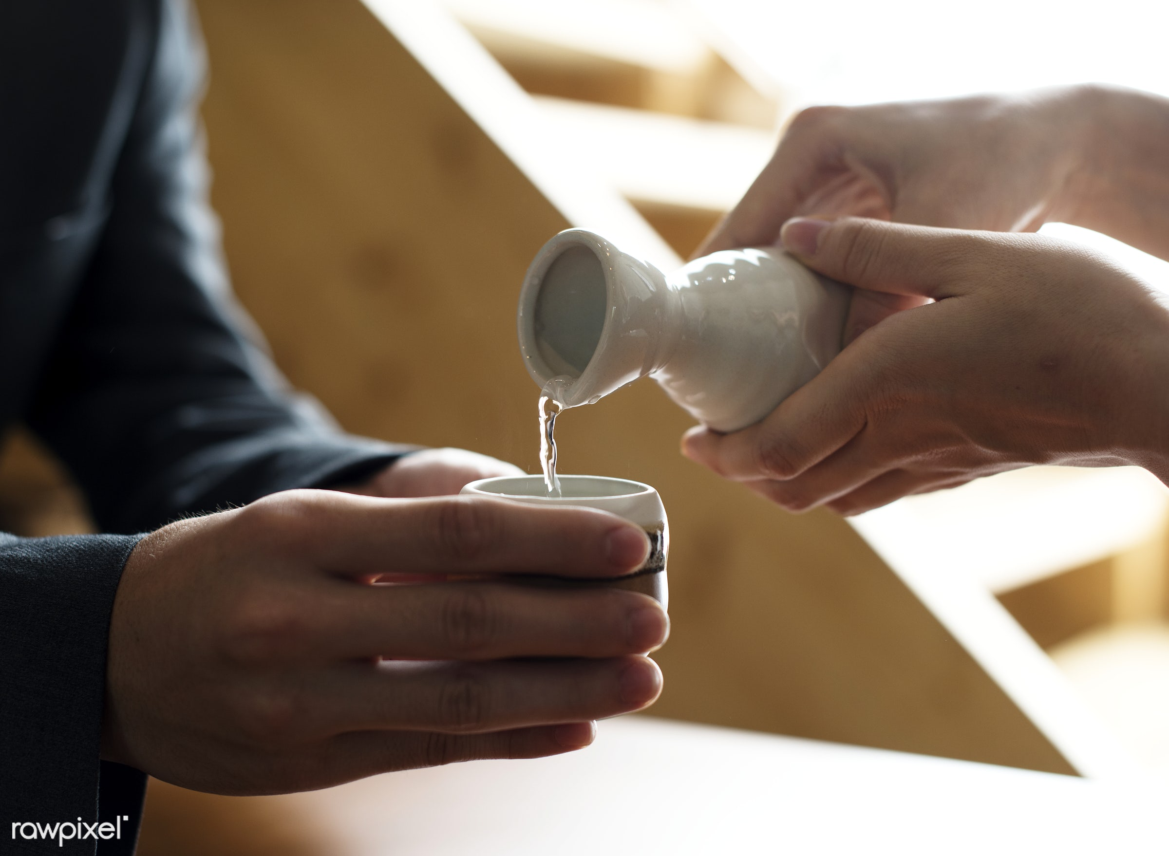Pouring sake - japan, alcohol, asia, asian, culture, drinking, japanese, liquor, people, pouring, sake, socialize, tavern,...