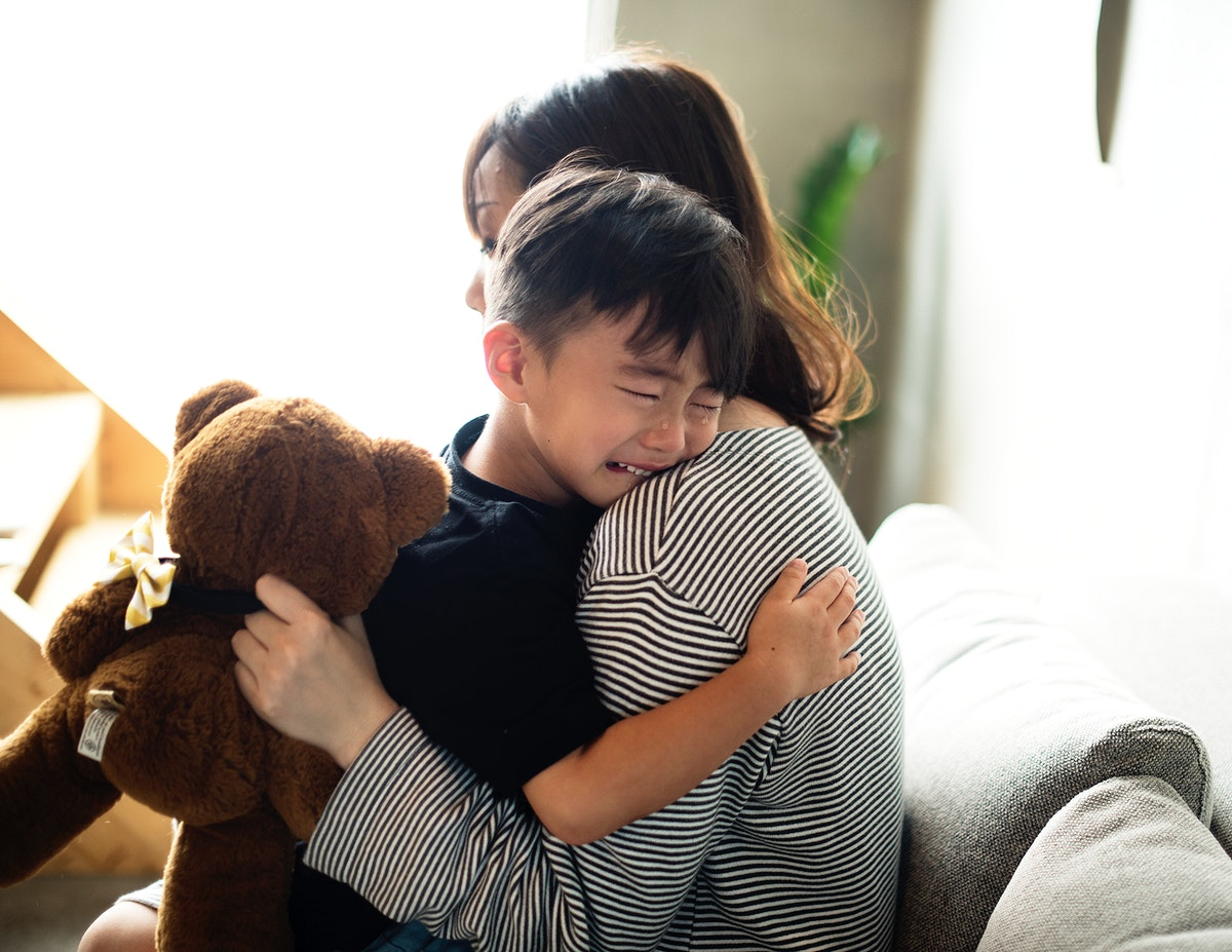 Japanese mother comforting her son
