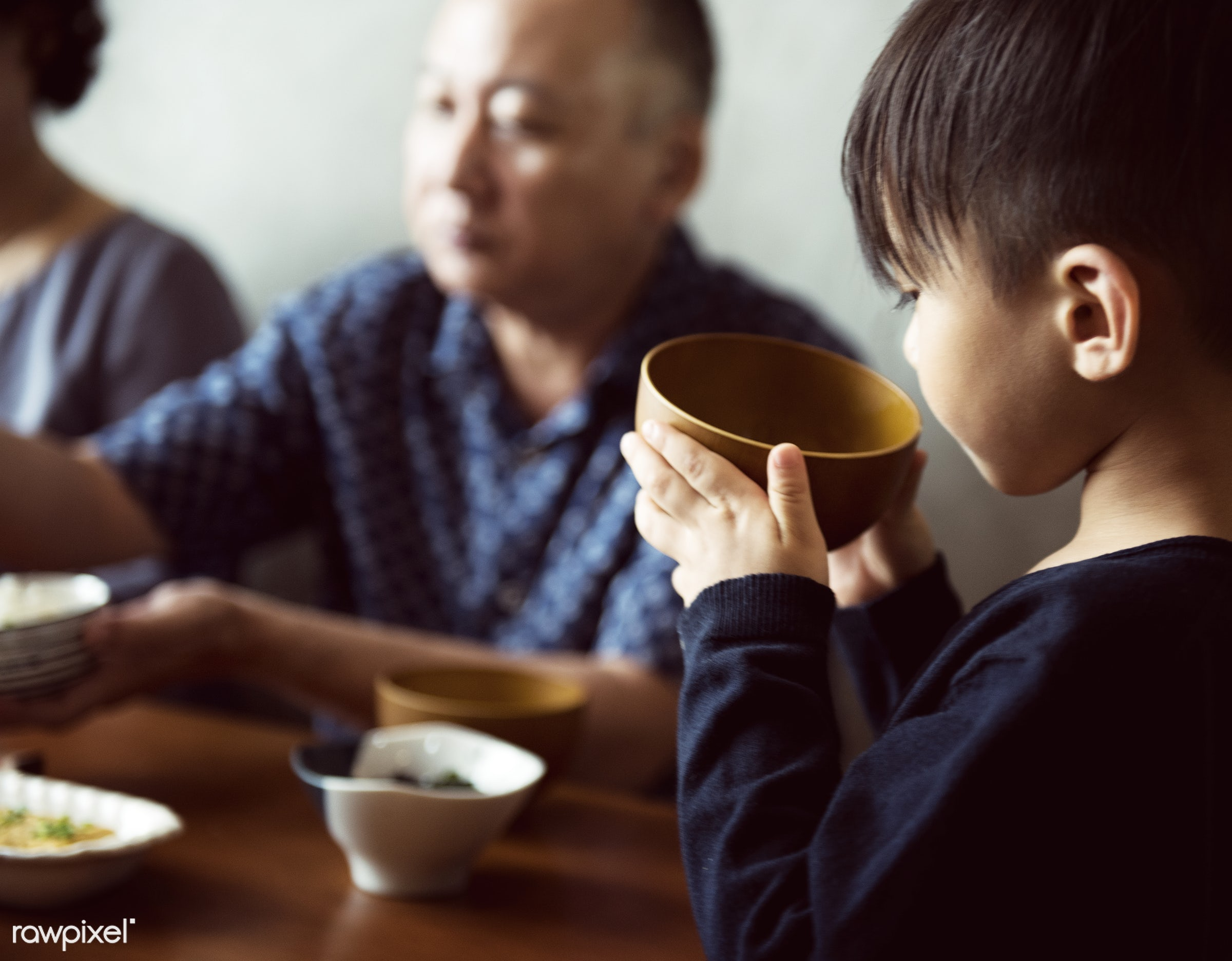Japanese boy holding a bowl of soup - food, japan, japanese, parent, asia, asian, bonding, culture, dining, dinner, eating,...