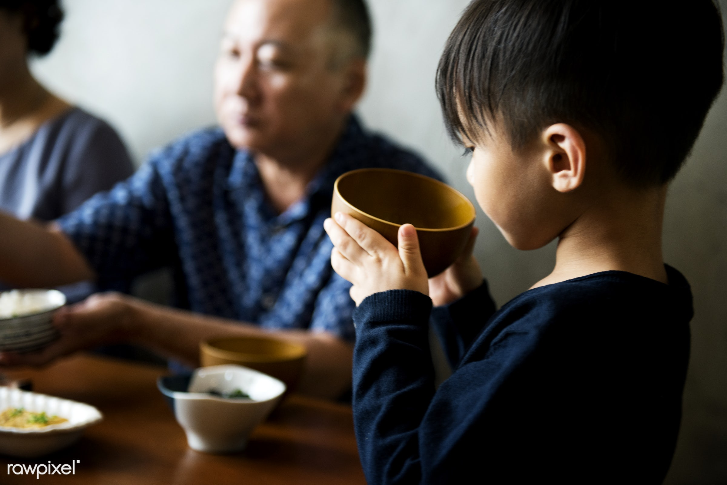 Japanese boy holding a bowl of soup - japan, asia, asian, bonding, breakfast, culture, dining, dinner, eating, family, food...