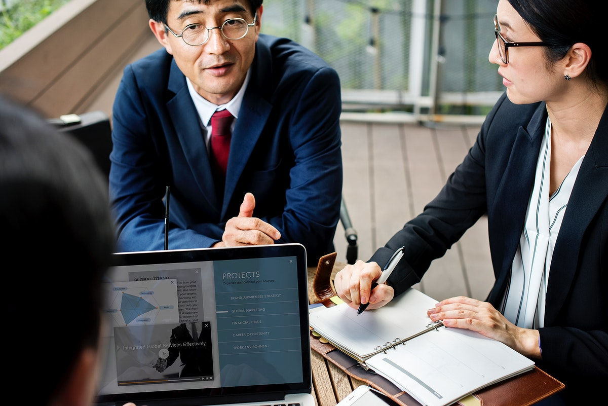 Japanese business people discussing