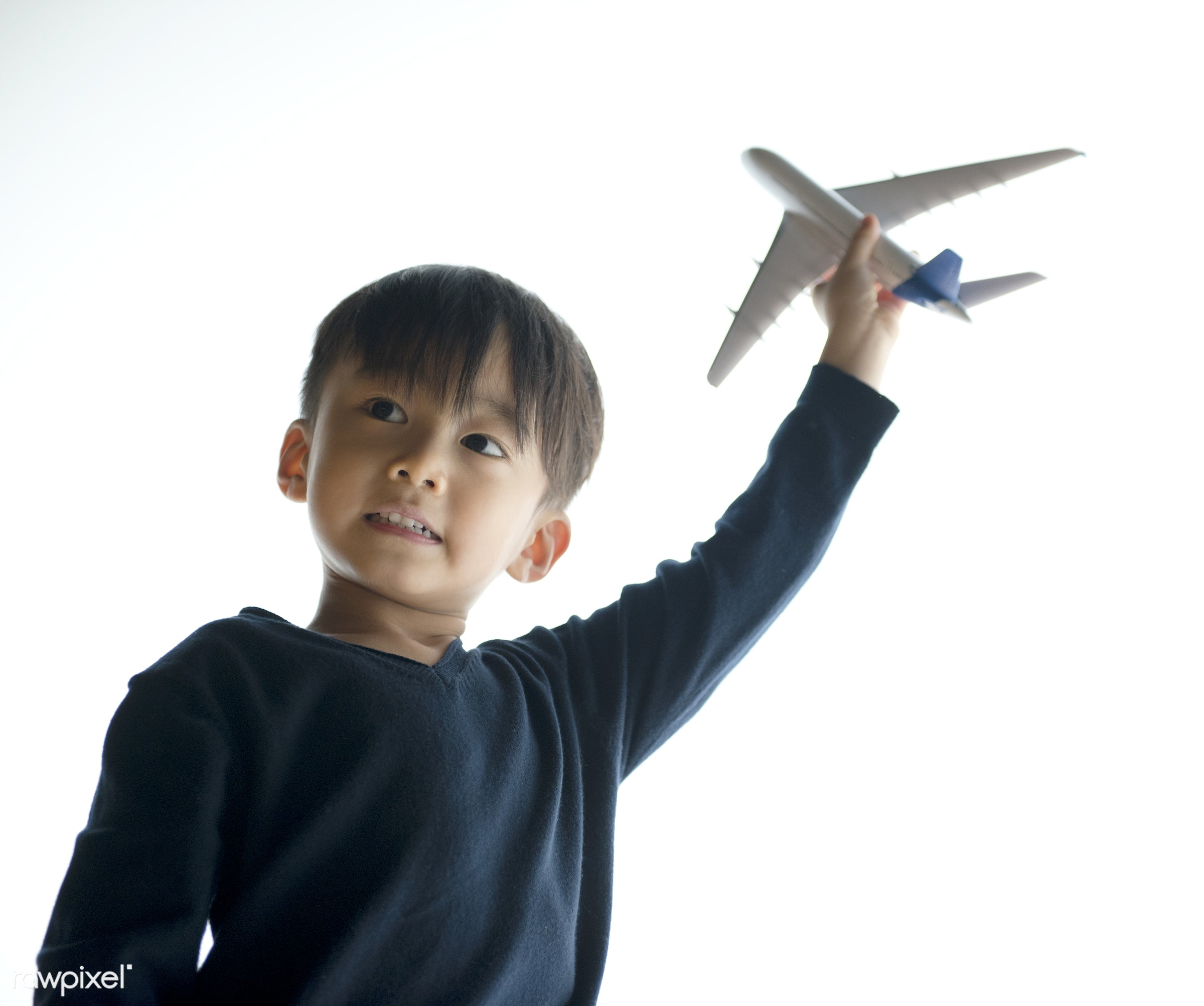 Japanese boy playing with his toy plane - child, adorable, asia, asian, boy, candid, casual, elementary age, imagination,...