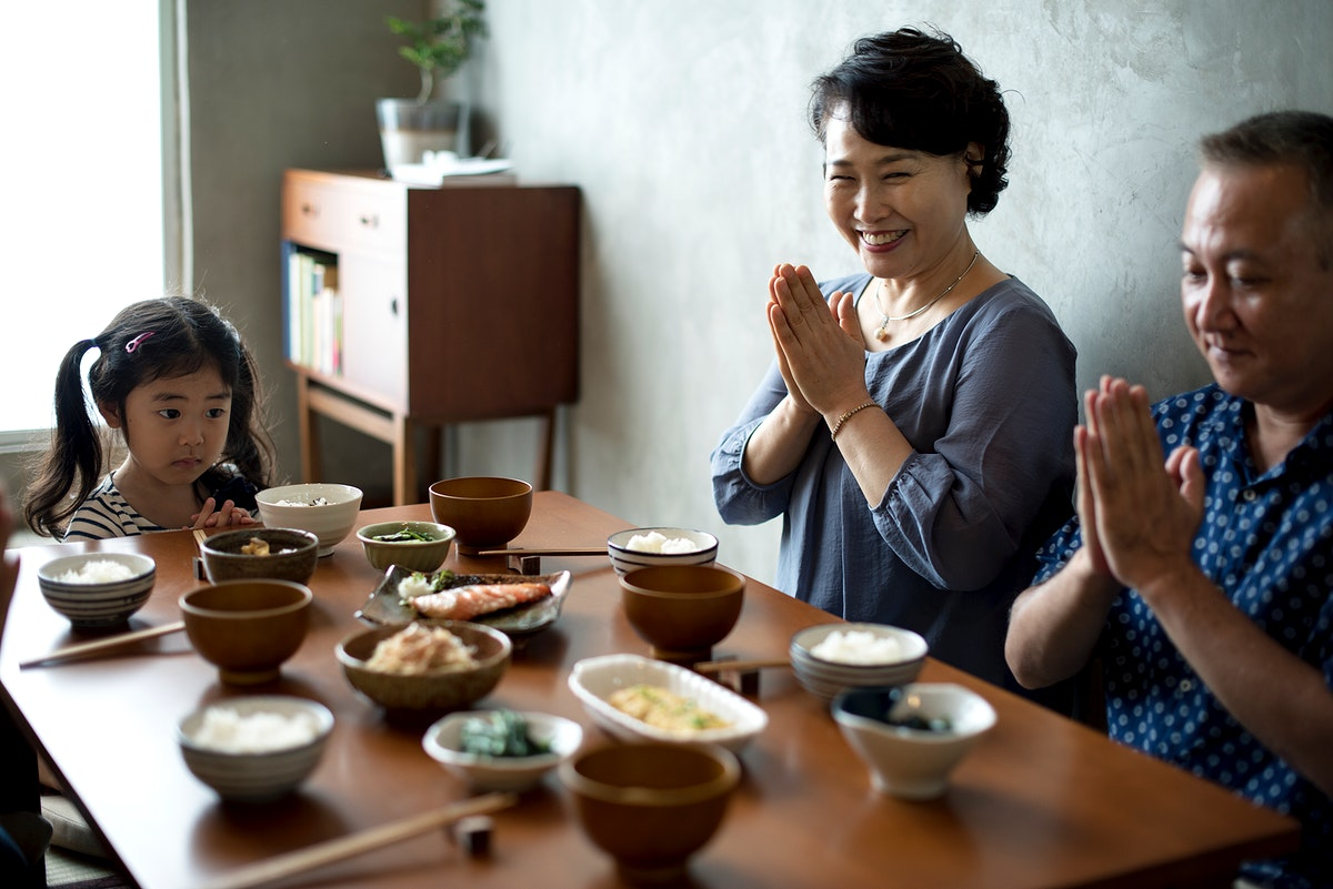 Japanese family praying together