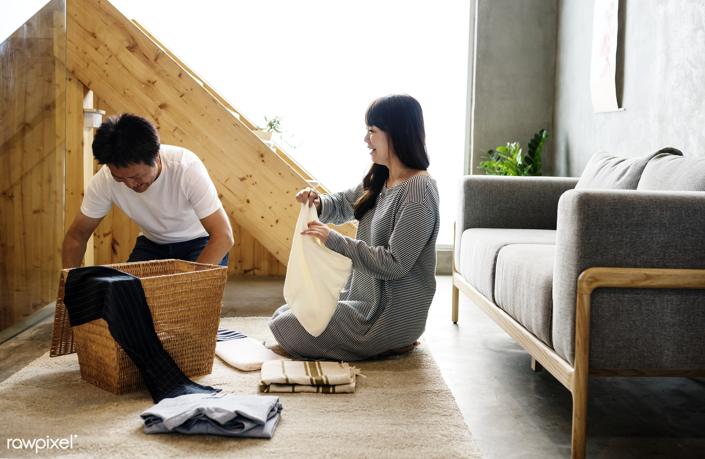 Japanese husband and wife folding clothes together - home, asian, living room, house, couple, fabric, housework, lifestyle,...