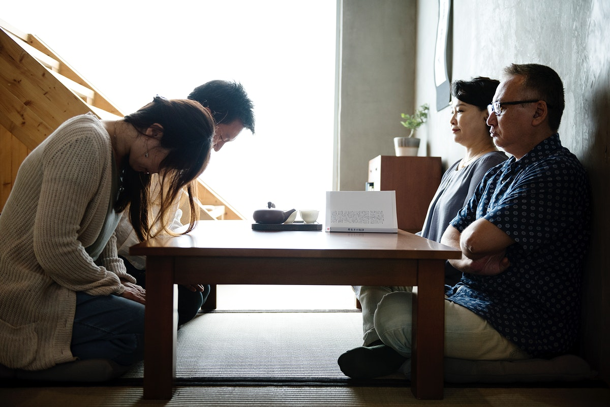 Japanese family greeting bowing with senior