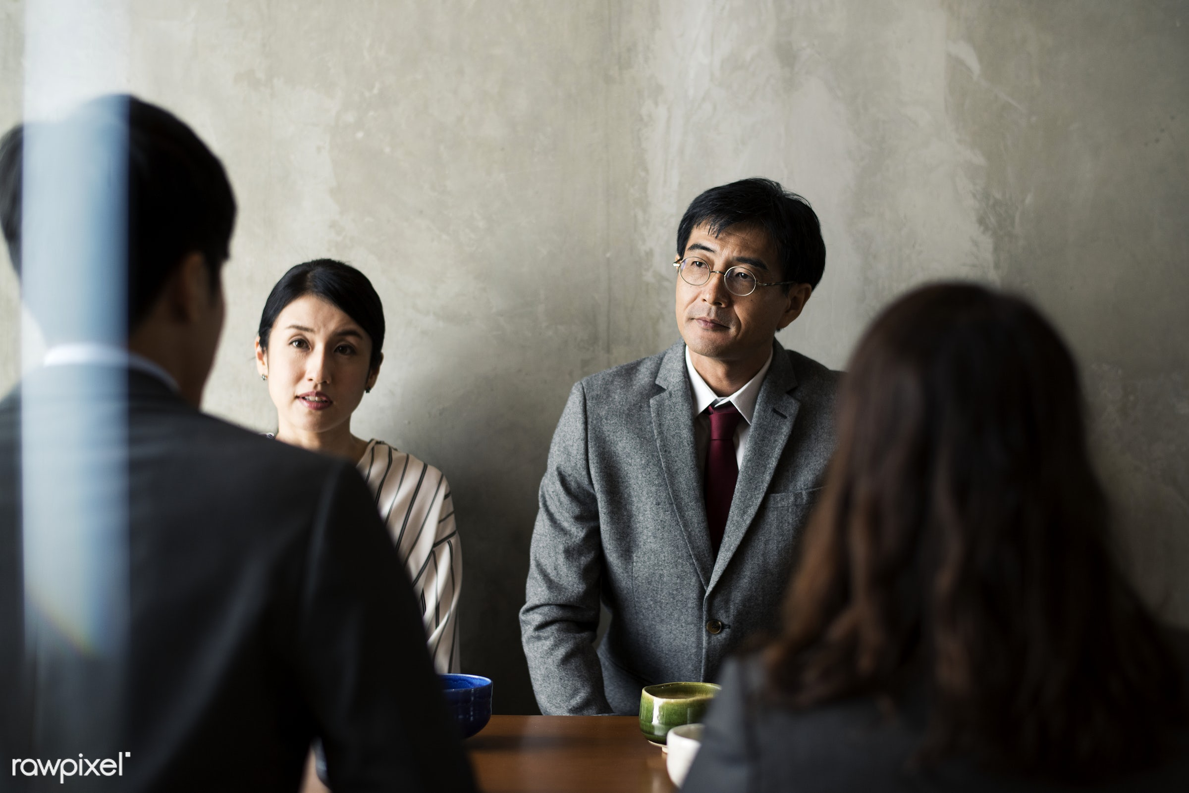 Japanese business people talking - asia, asian, business, business people, businessmen, businesswomen, cafe, coffee shop,...