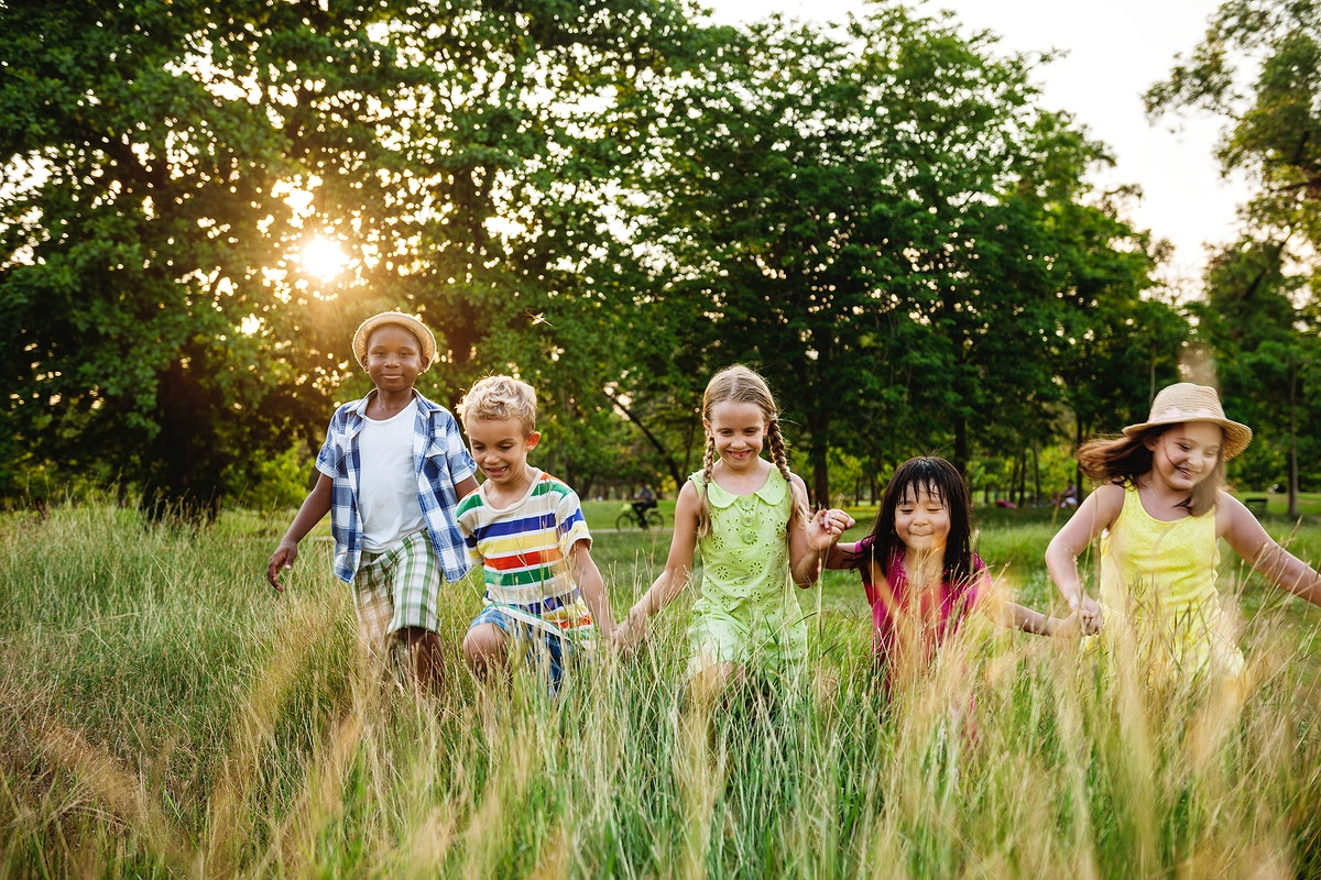 Group of diverse kids playing in the park