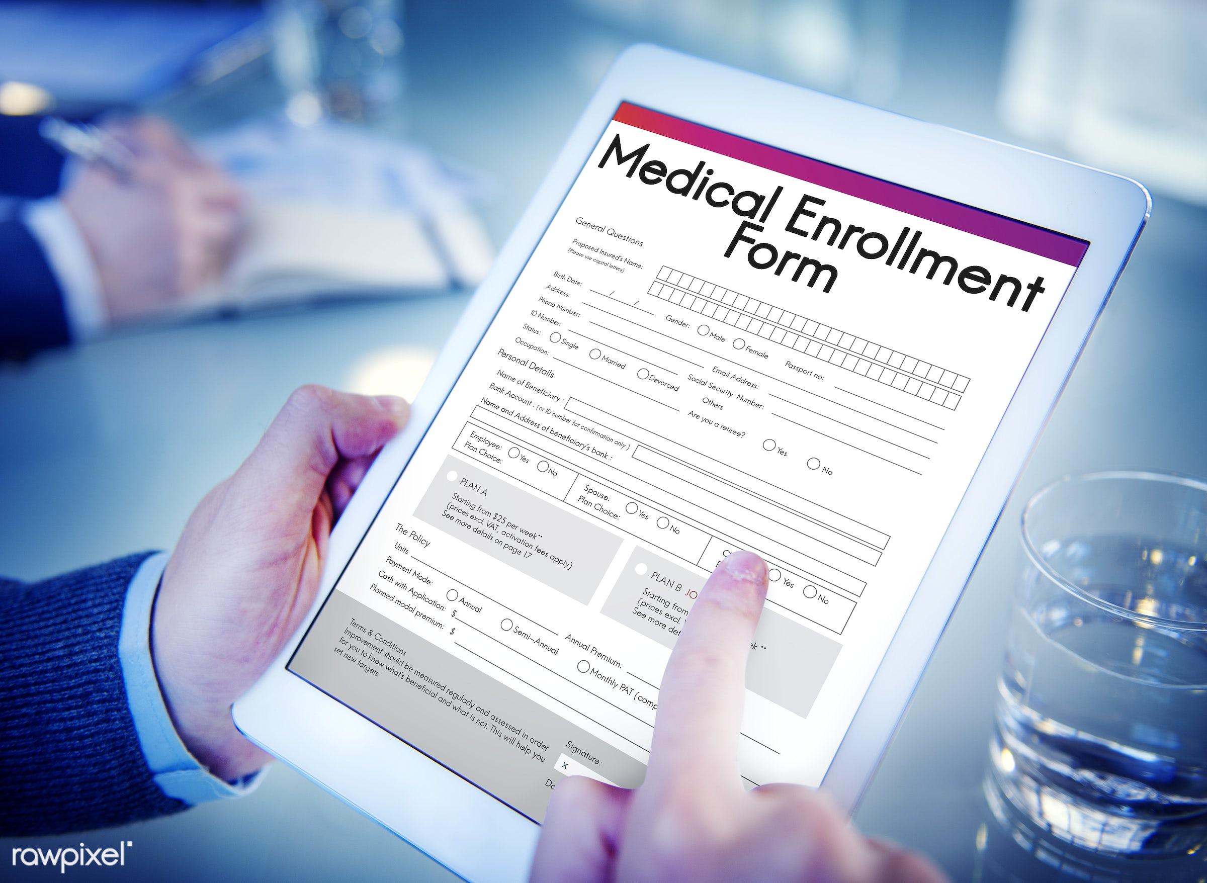 Medical Enrollment Form Document Medicare Concept - alone, business, businessman, closeup, device, digital, graphic, man,...