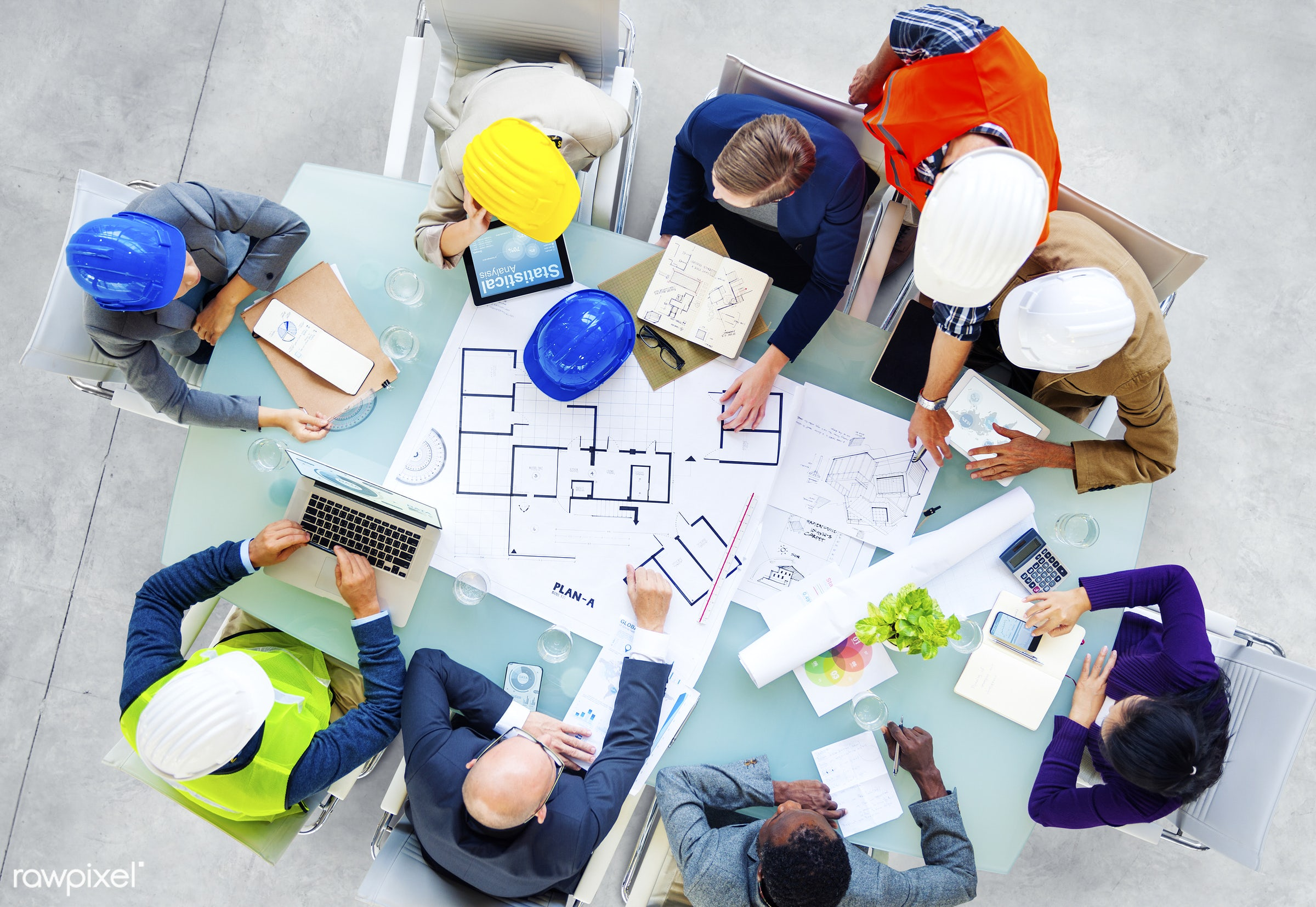 Group of site construction workers having a meeting - architect, architecture, blue print, board, brainstorm, construction,...