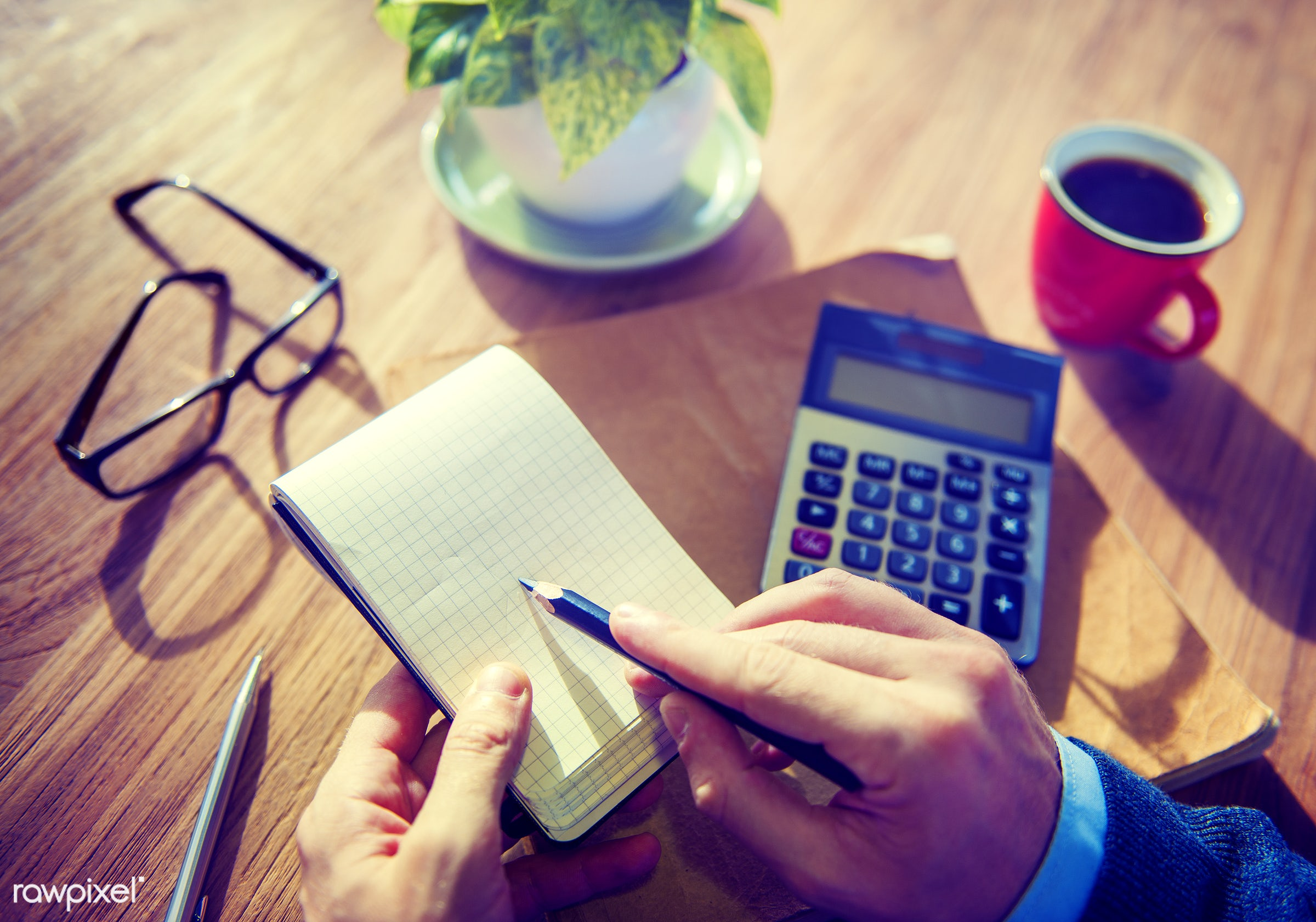 Closeup of hands writing on notepad - beverage, business, businessman, calculator, coffee, cup, drink, hands, note, notepad...